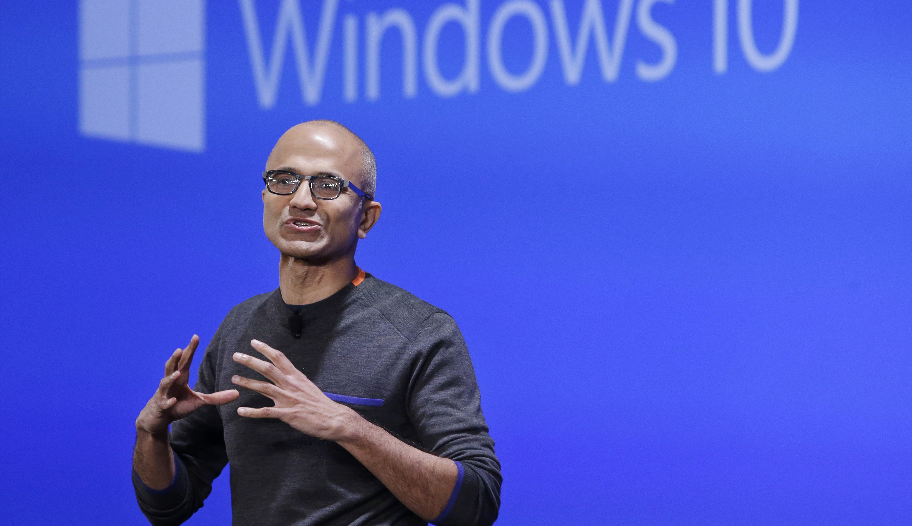 FILE - In this Jan. 21, 2015, file photo, Microsoft CEO Satya Nadella speaks at an event demonstrating the new features of Windows 10 at the company's headquarters in Redmond, Wash. When Chinese President Xi Jinping arrives in Washington state on his way to the other Washington (Washington, D.C.), he'll be visiting the American state that does more business with his country than any other. Washington companies sold China more than $20 billion in products last year, from airplanes to wheat and apples. (AP Photo/Elaine Thompson, File)