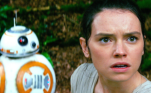 Daisy Ridley and BB-8 in Star Wars: The Force Awakens.