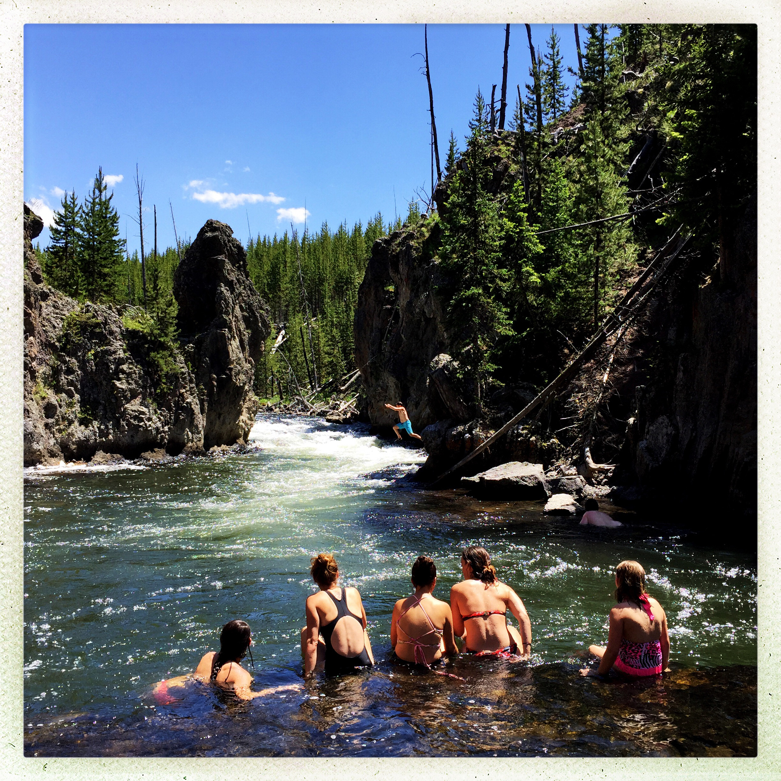 YELLOWSTONE NATIONAL PARK, WY - JUNE 19: Visitors cool off in t