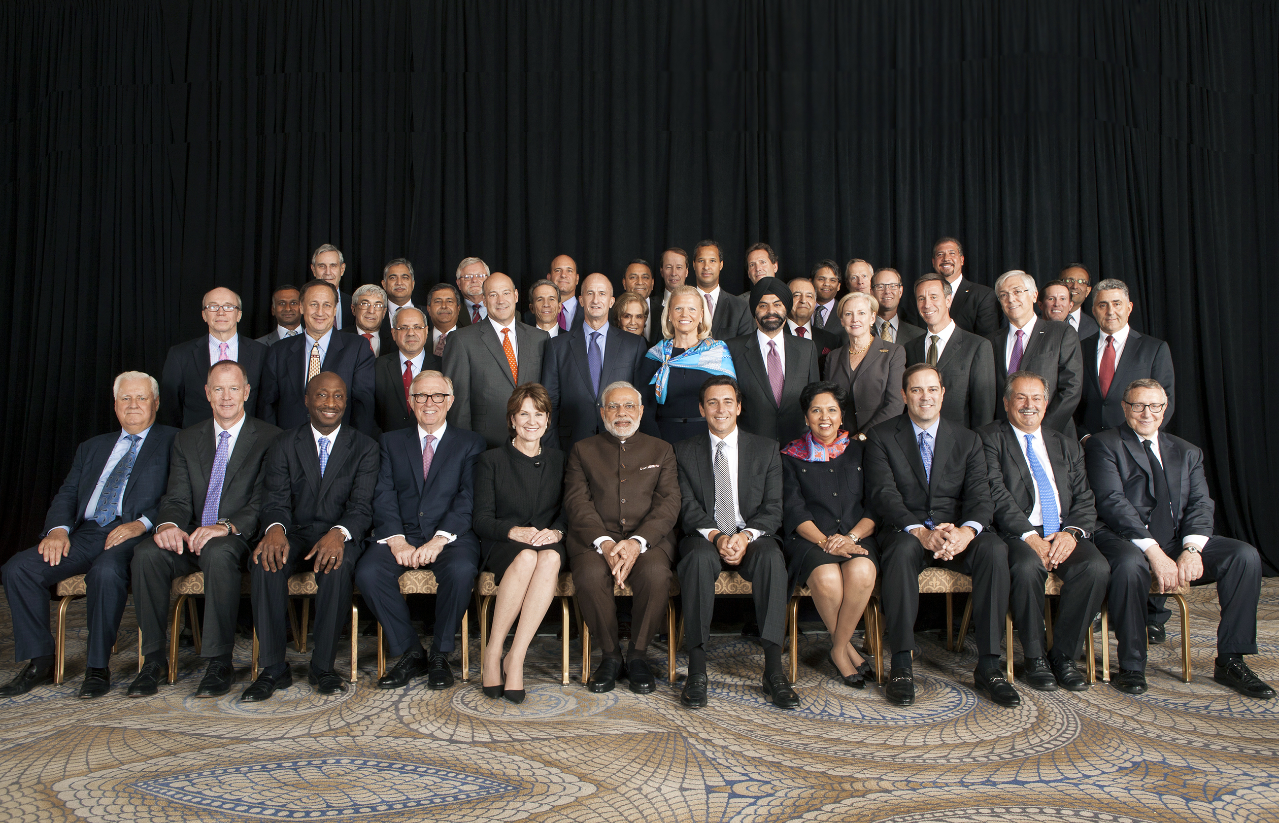 Prime Minister Narendra Modi (center) welcomes a throng of top executives at a 2015 Fortune summit in New York.