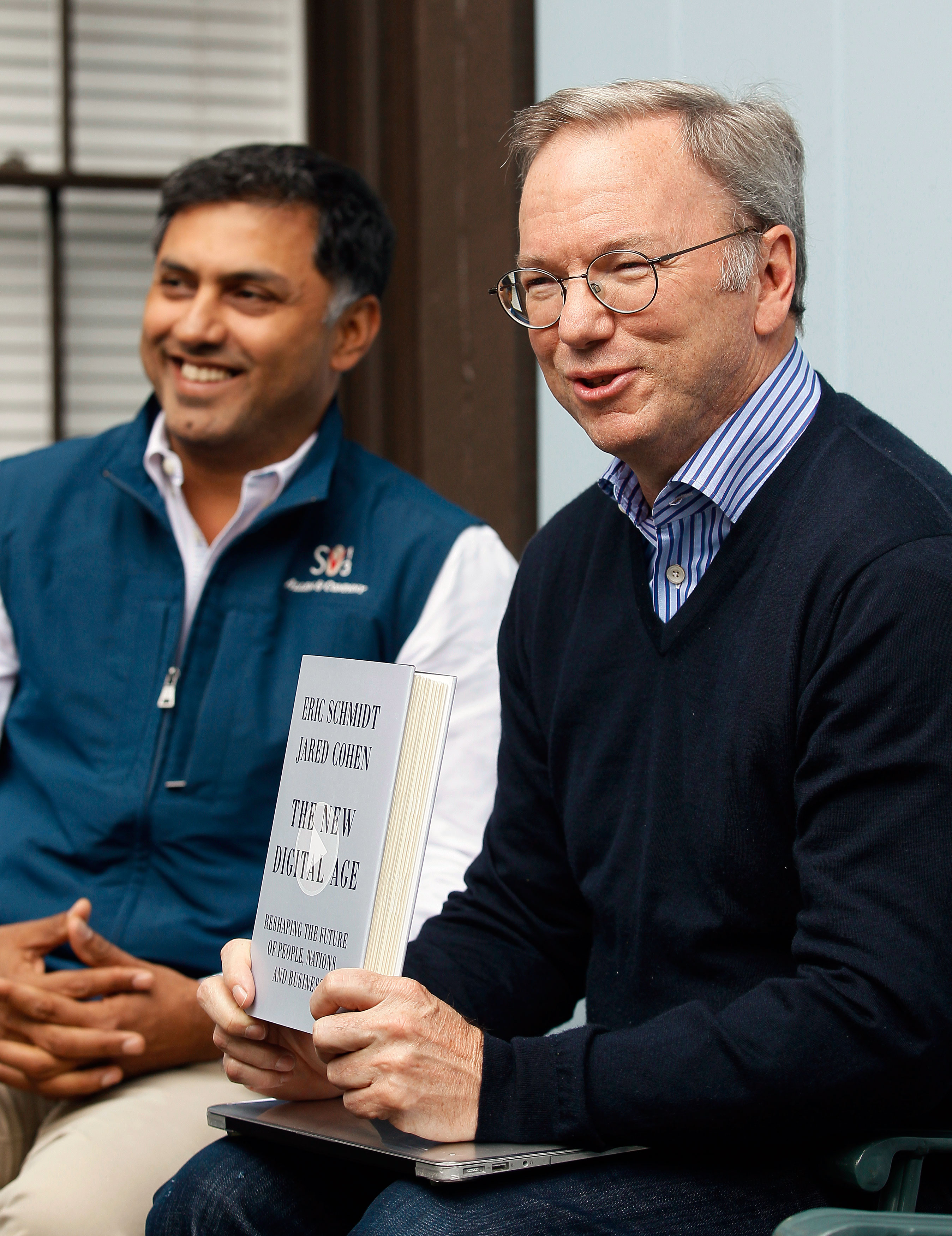 Eric Schmidt, executive chairman of Google holds up his book with Nikesh Arora, Google chief business officer at the annual Allen and Co. conference in Sun Valley