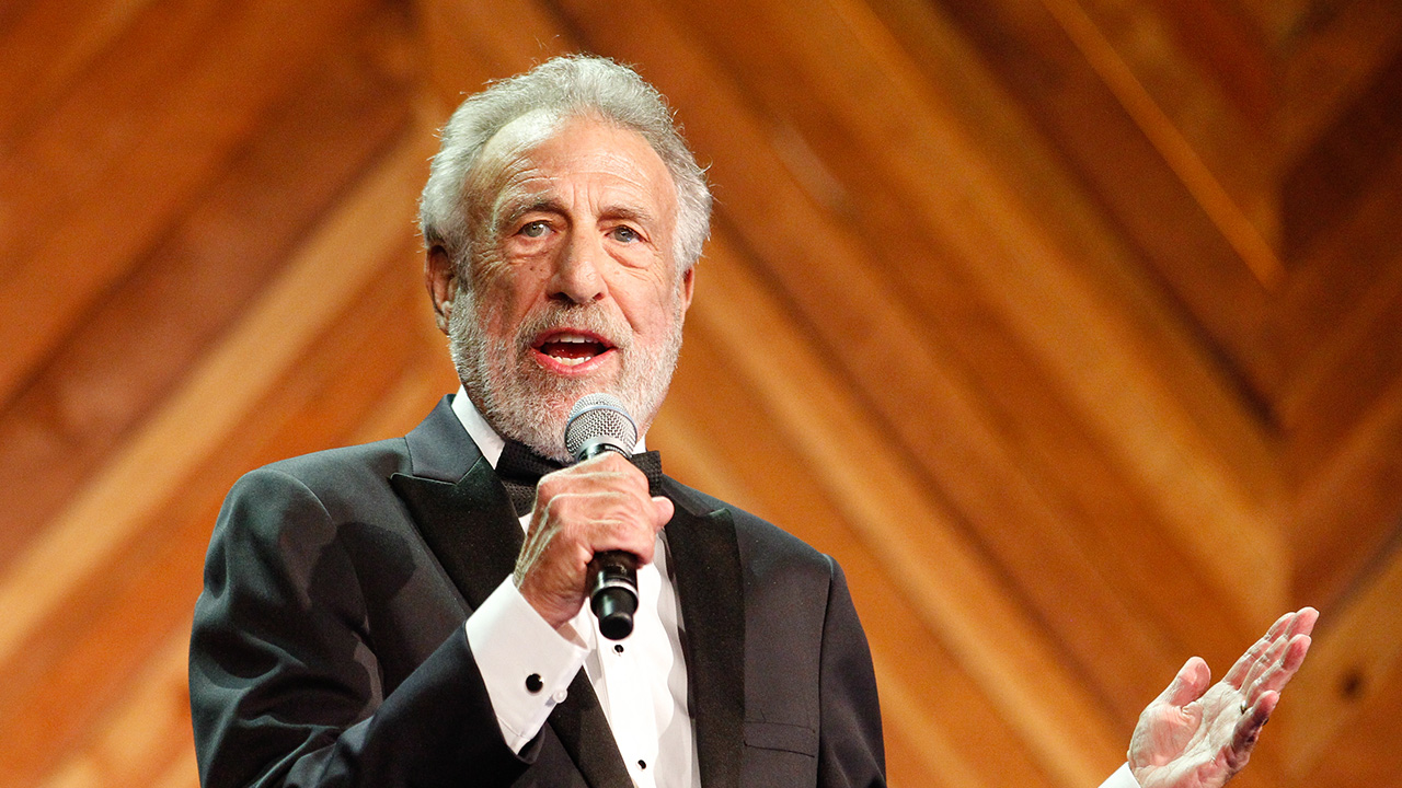 George Zimmer, founder of The Men's Wearhouse, is talking to private equity groups about buying the company he started.
