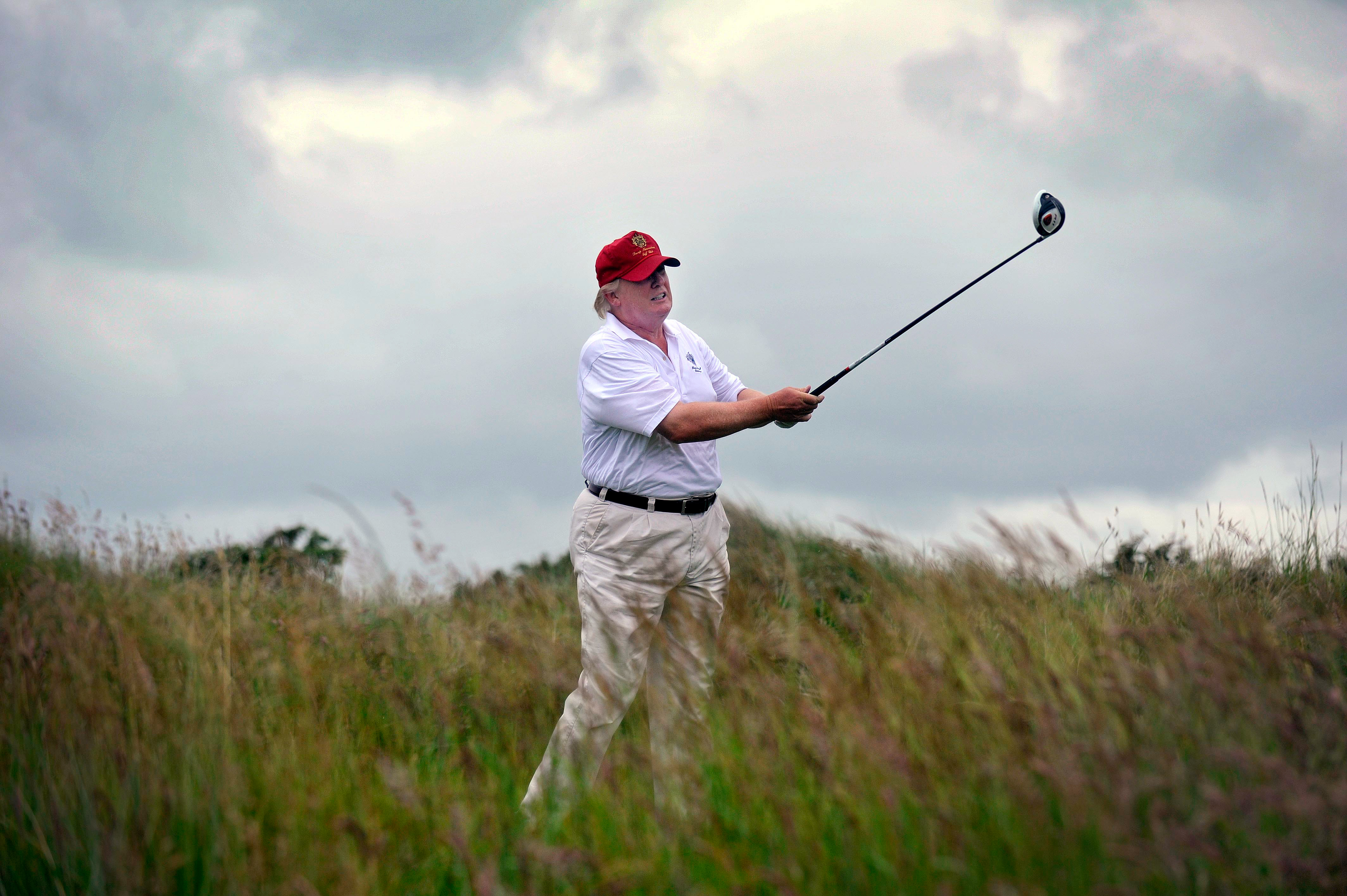 Donald Trump playing at one of his golf courses in Scotland.