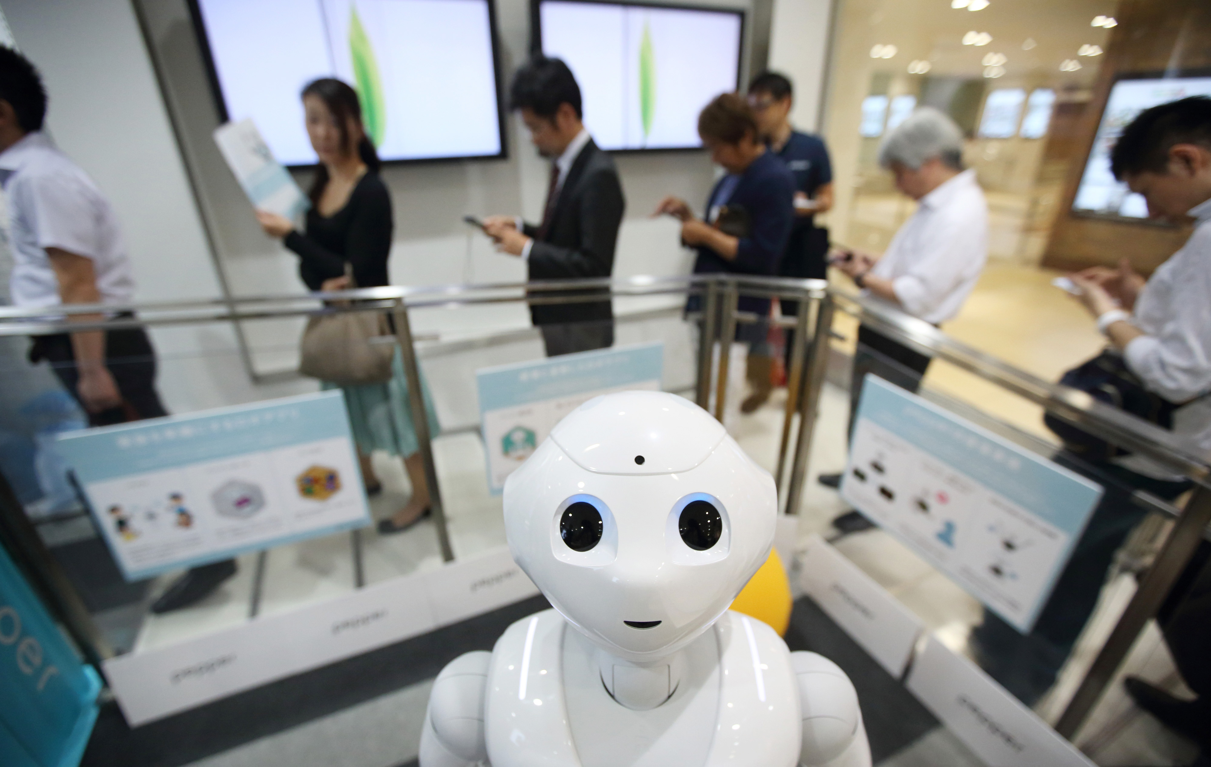 Customers At A SoftBank Corp. Store As Pre-Order For Pepper Robot Begins
