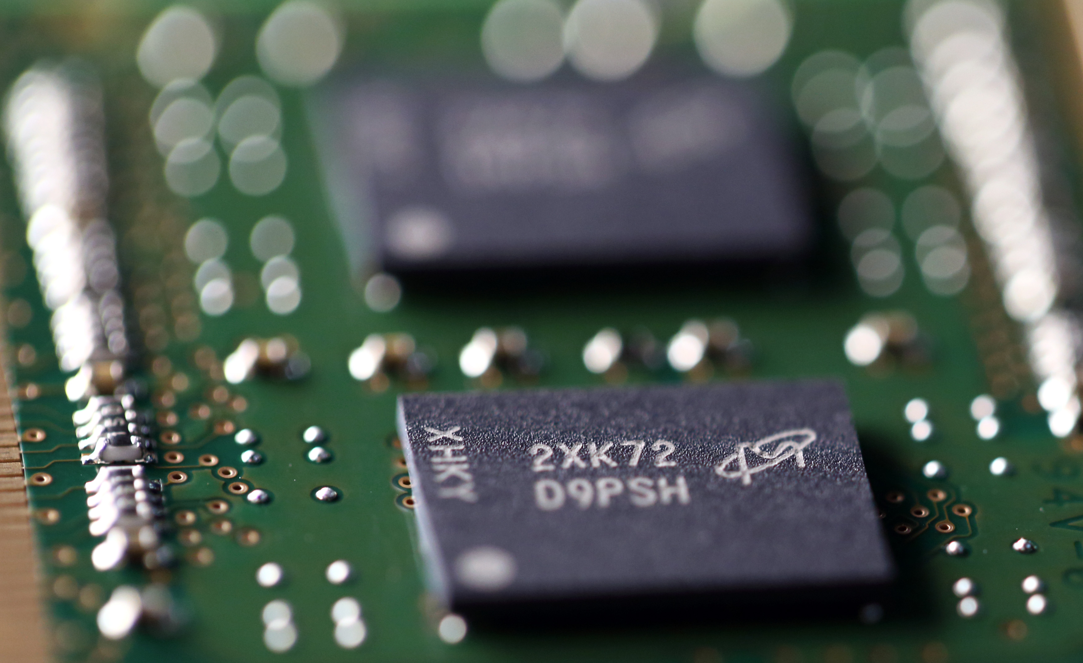 Micron Technology Inc. Double-Data-Rate Synchronous Random-Access Memory (SDRAM) chips are arranged for a photograph in Tokyo, Japan, on Wednesday, July 15, 2015.