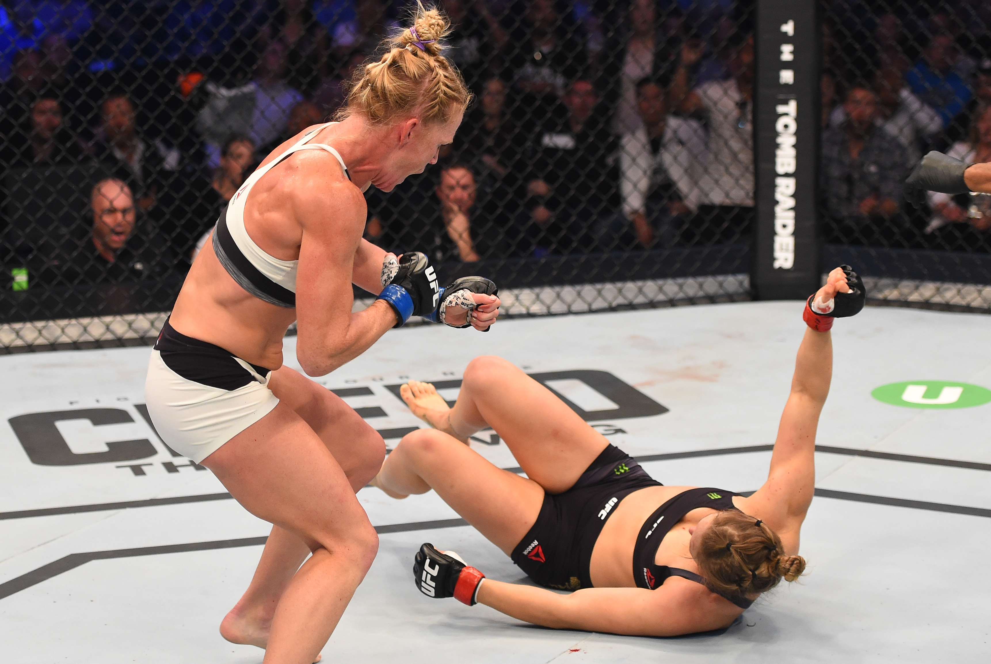 (L-R) Holly Holm of the United States follows up after knocking down Ronda Rousey of the United States with a kick in their UFC women's bantamweight championship bout during the UFC 193 event at Etihad Stadium on November 15, 2015 in Melbourne, Australia.