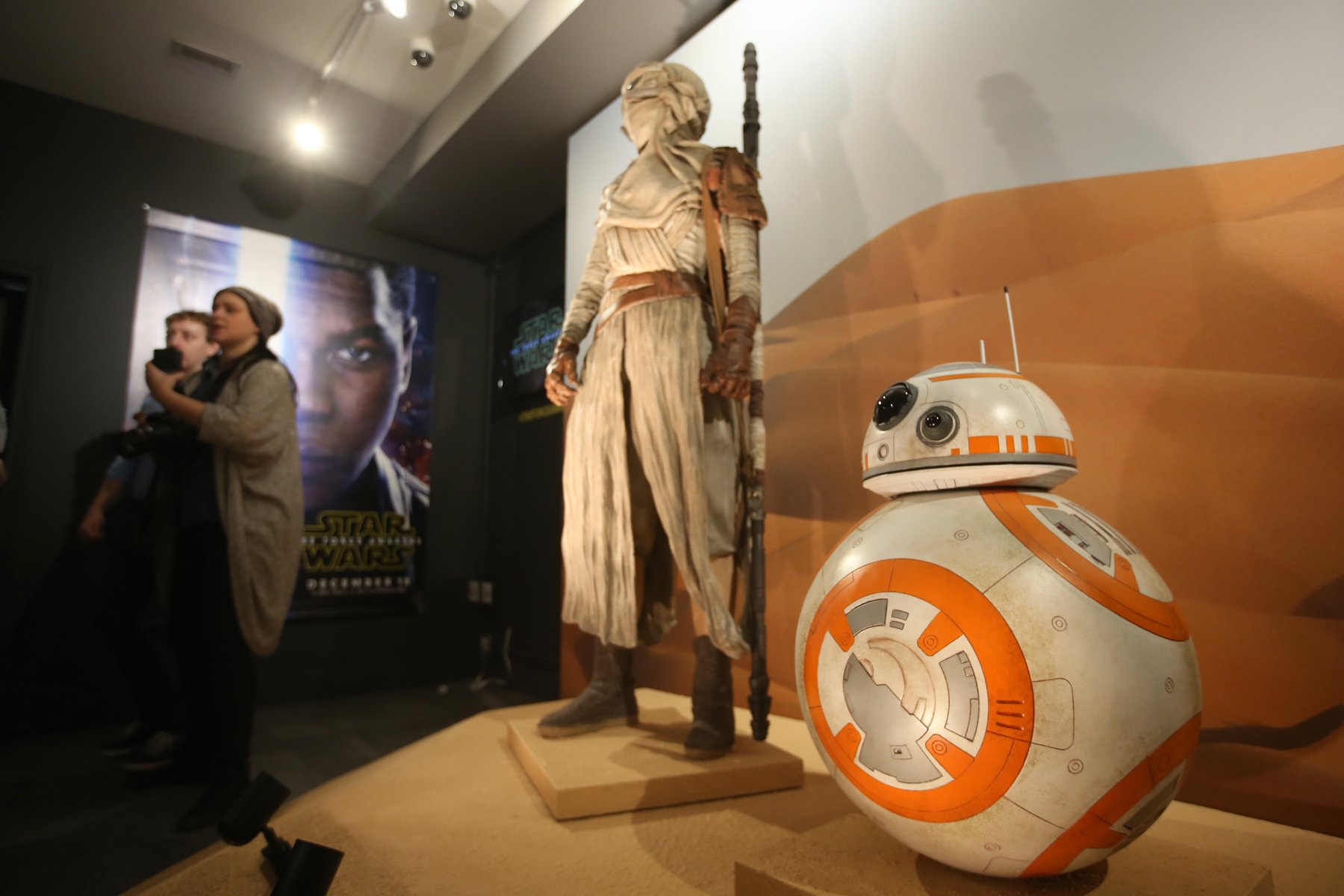 "Star Wars characters Rey, left, and BB-8, right,  who appear in the forthcoming movie  ""The Force Awakens."""