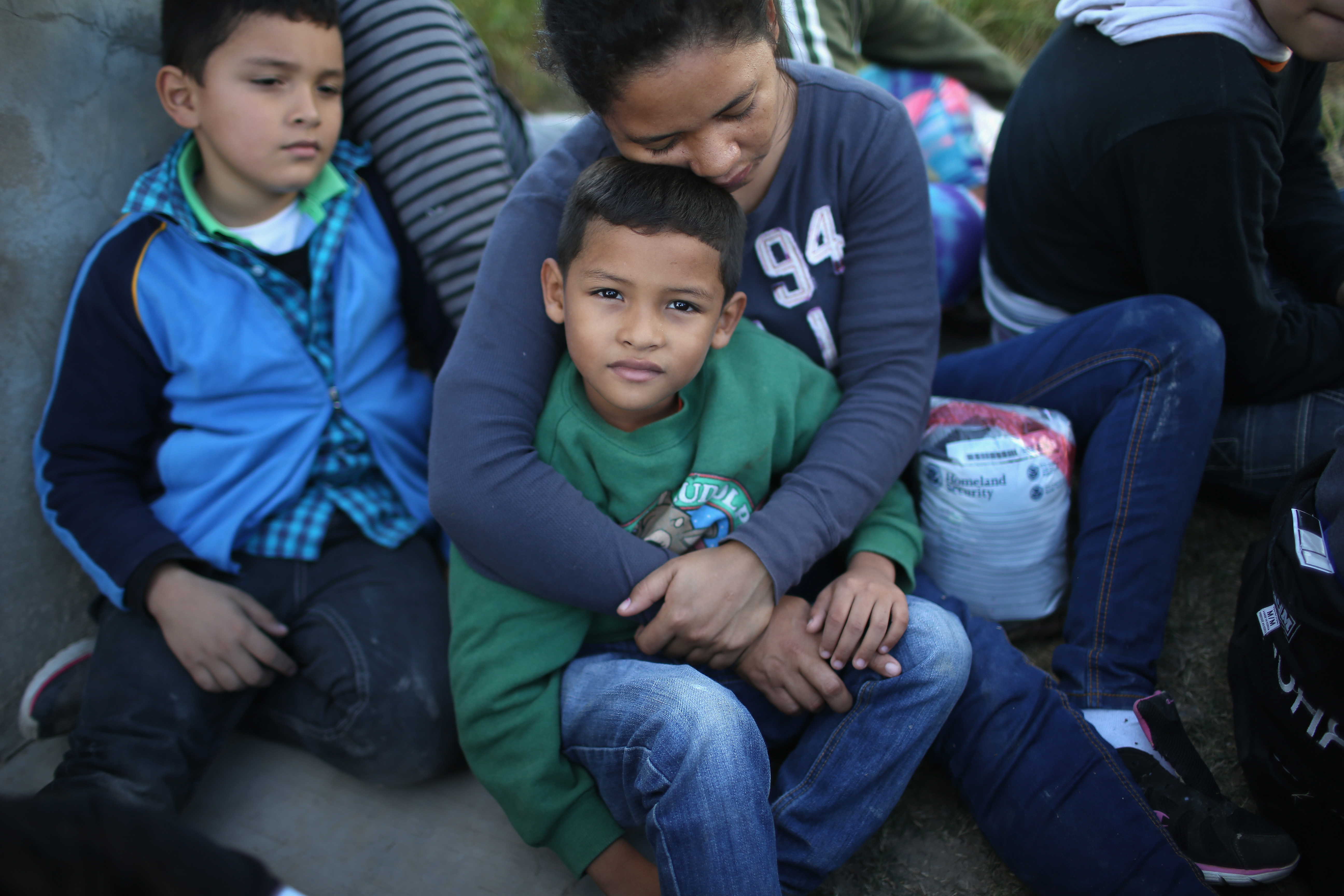 A Honduran mother holds her son, 7, after she turned her family in to U.S. Border Patrol agents near Rio Grande City, Texas.