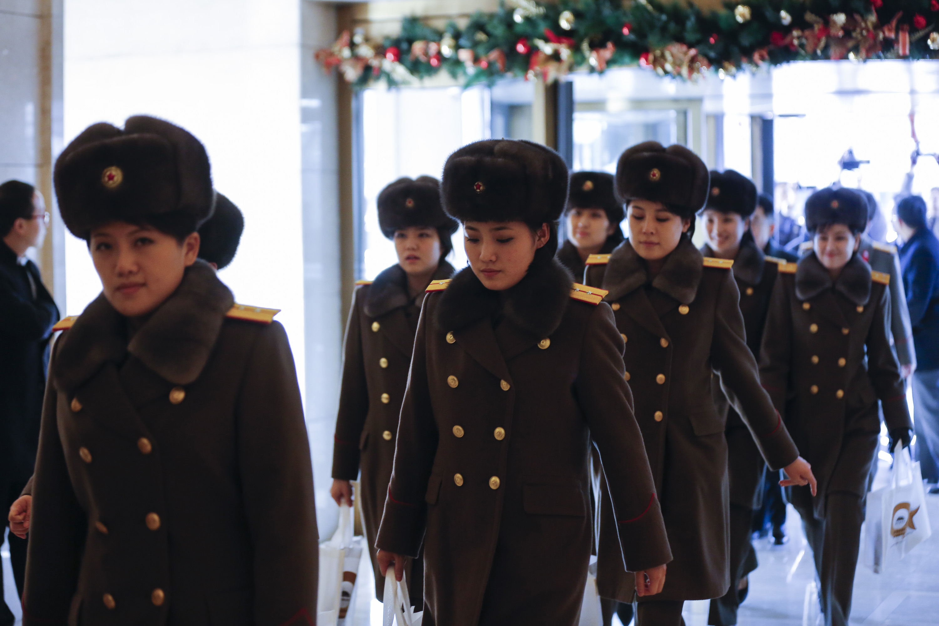 BEIJING, CHINA - DECEMBER 11: (CHINA OUT) Members of the North Korean female music group Moranbong Band arrive at a hotel after concert rehearsal on December 11, 2015 in Beijing, China. The Moranbong Band will perform at the National Centre for the Performing Arts from December 12 to 14. (Photo by ChinaFotoPress)***_***