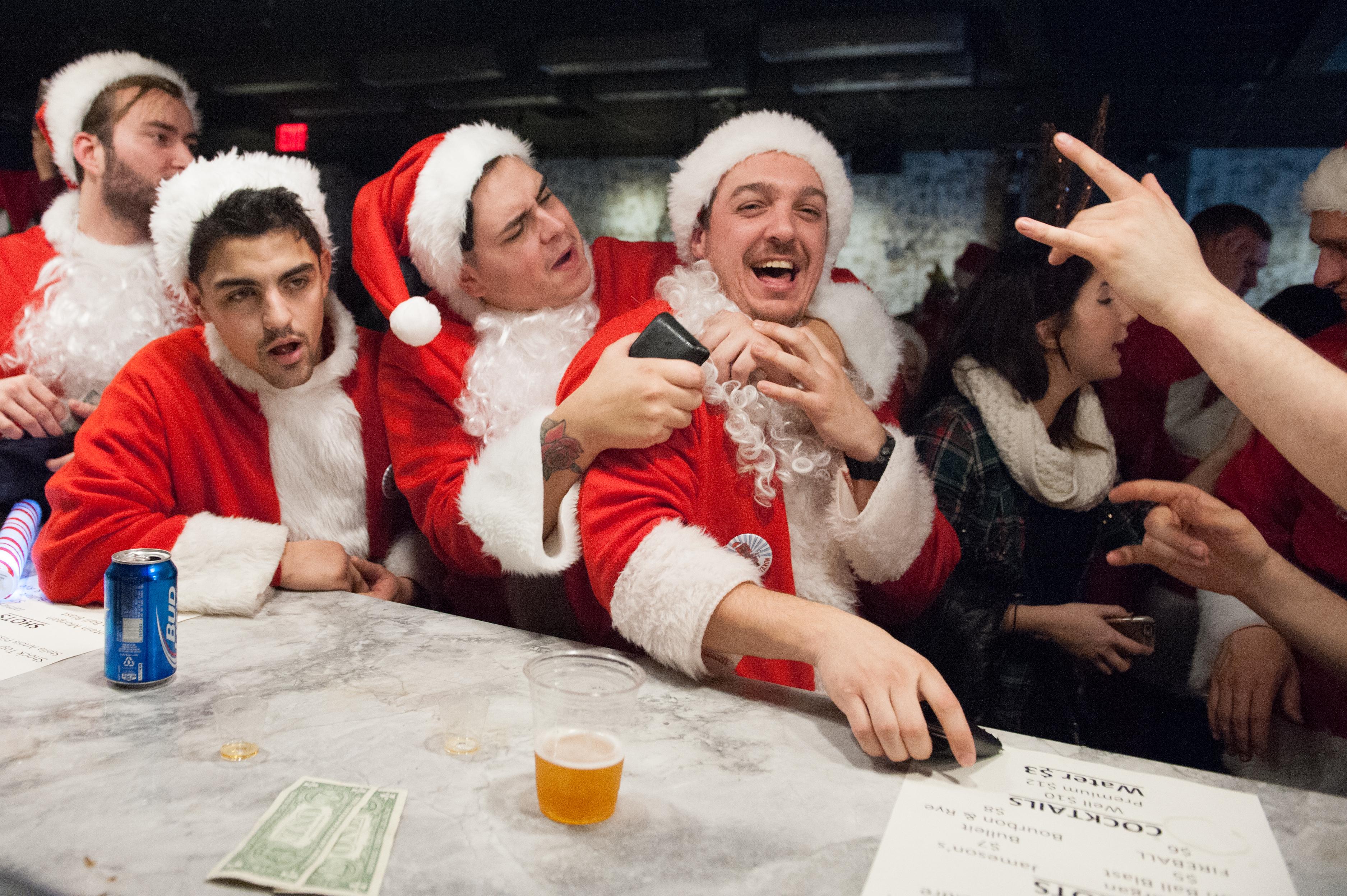 Annual SantaCon Pub Crawl Held In New York City