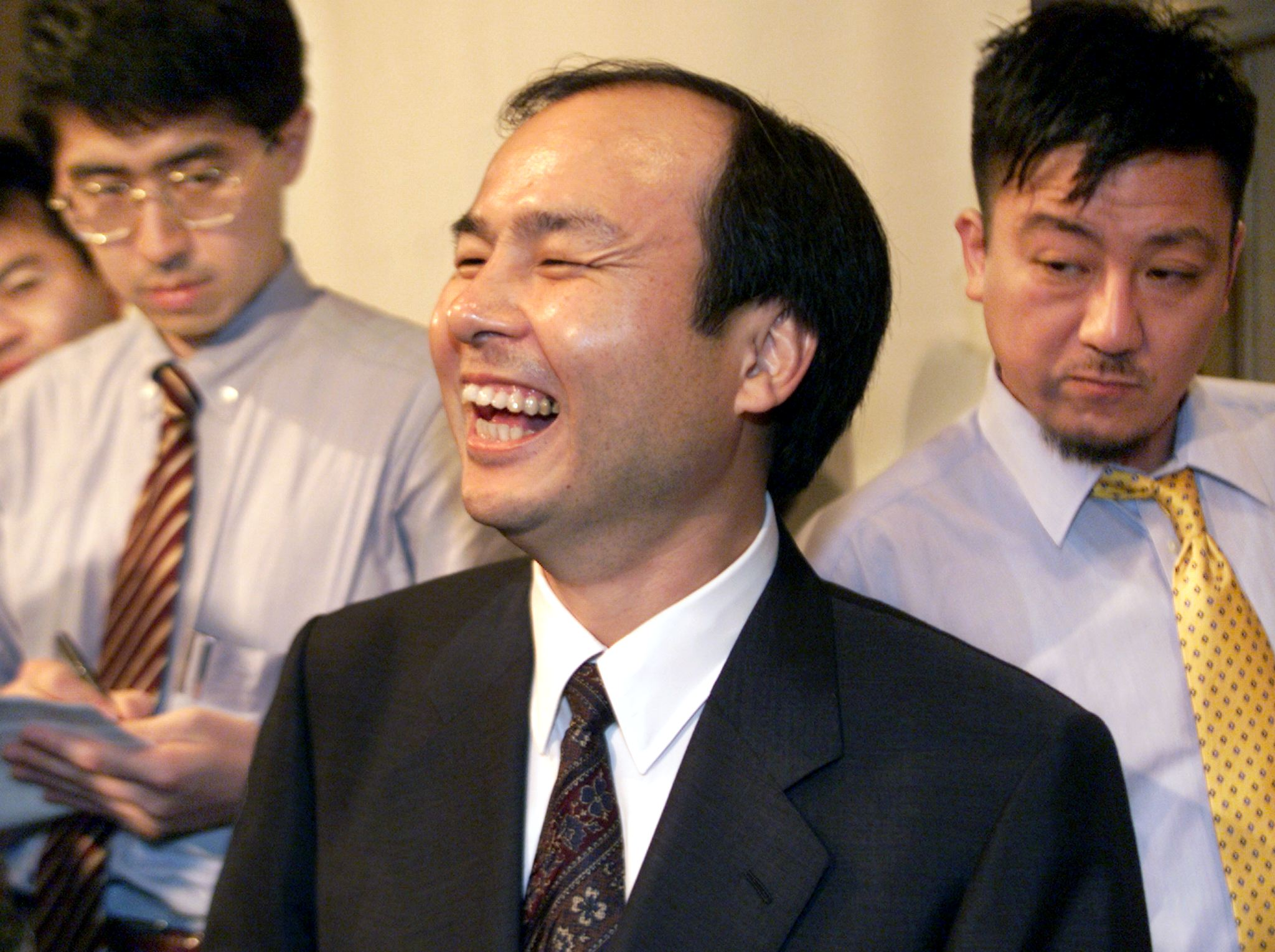 Masayoshi Son (C), president of Japan's major Inte