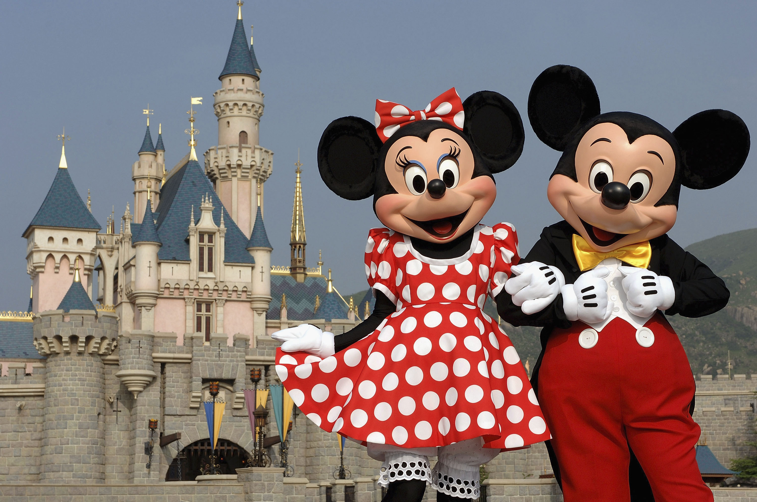 In a photo taken Sept. 1, 2005, Mickey Mouse and Minnie Mouse are seen in front of Sleeping Beauty Castle at Hong Kong Disneyland Park.  The new theme park and vacation resort will officially open Sept. 12, 2005.  Hong Kong Disneyland Resort is a family entertainment and recreation center consisting of a full-day, Disneyland-style theme park, two Disney hotels and a lakeside recreation center. (Mark Ashman, photographer)