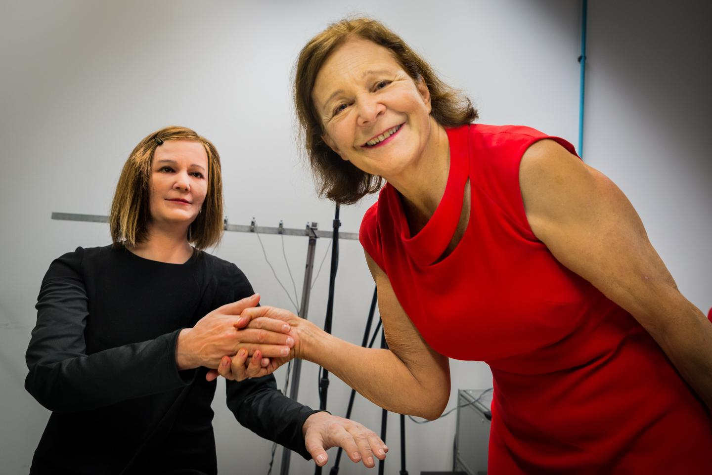 'Nadine,' a new humanoid receptionist (left), can respond to moods and remember your conversations. Computer Science Professor Nadia Thalmann (right) developed the tech with researchers at Nanyang Technological University.