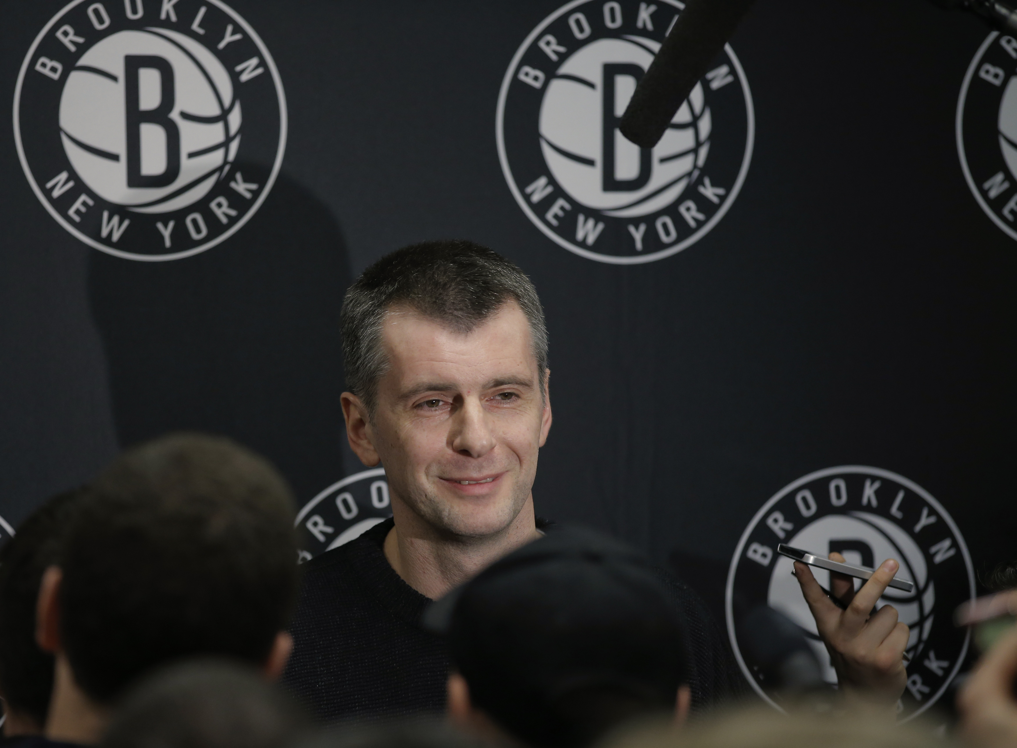 Brooklyn Nets owner Prokhorov talks with the media about his decision to fire head coach Johnson, at half time of their NBA basketball game with the Charlotte Bobcats in New York