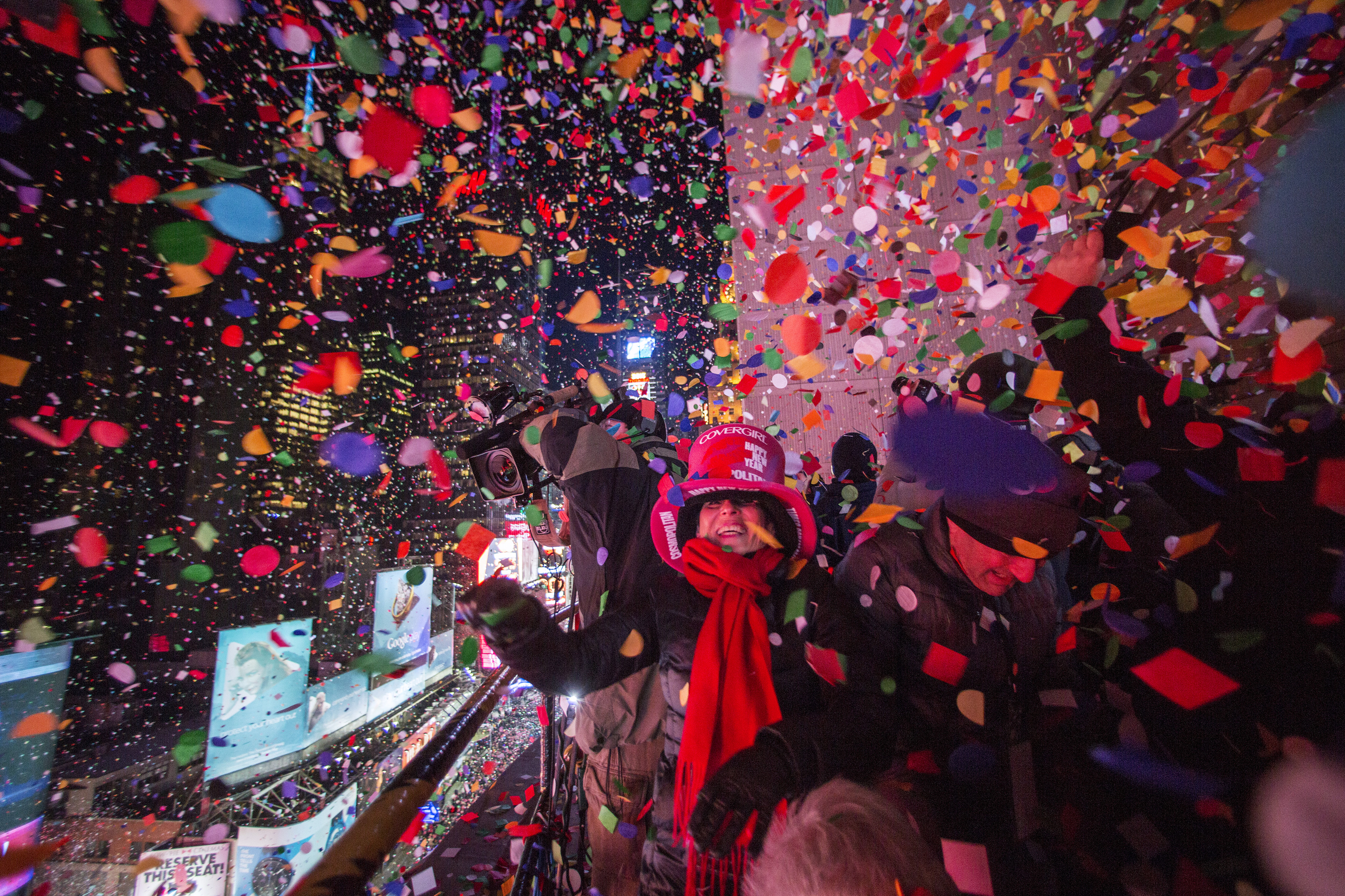 Revellers toss confetti over Times Square from a hotel after the clock struck midnight during New Year's Eve celebrations in New York