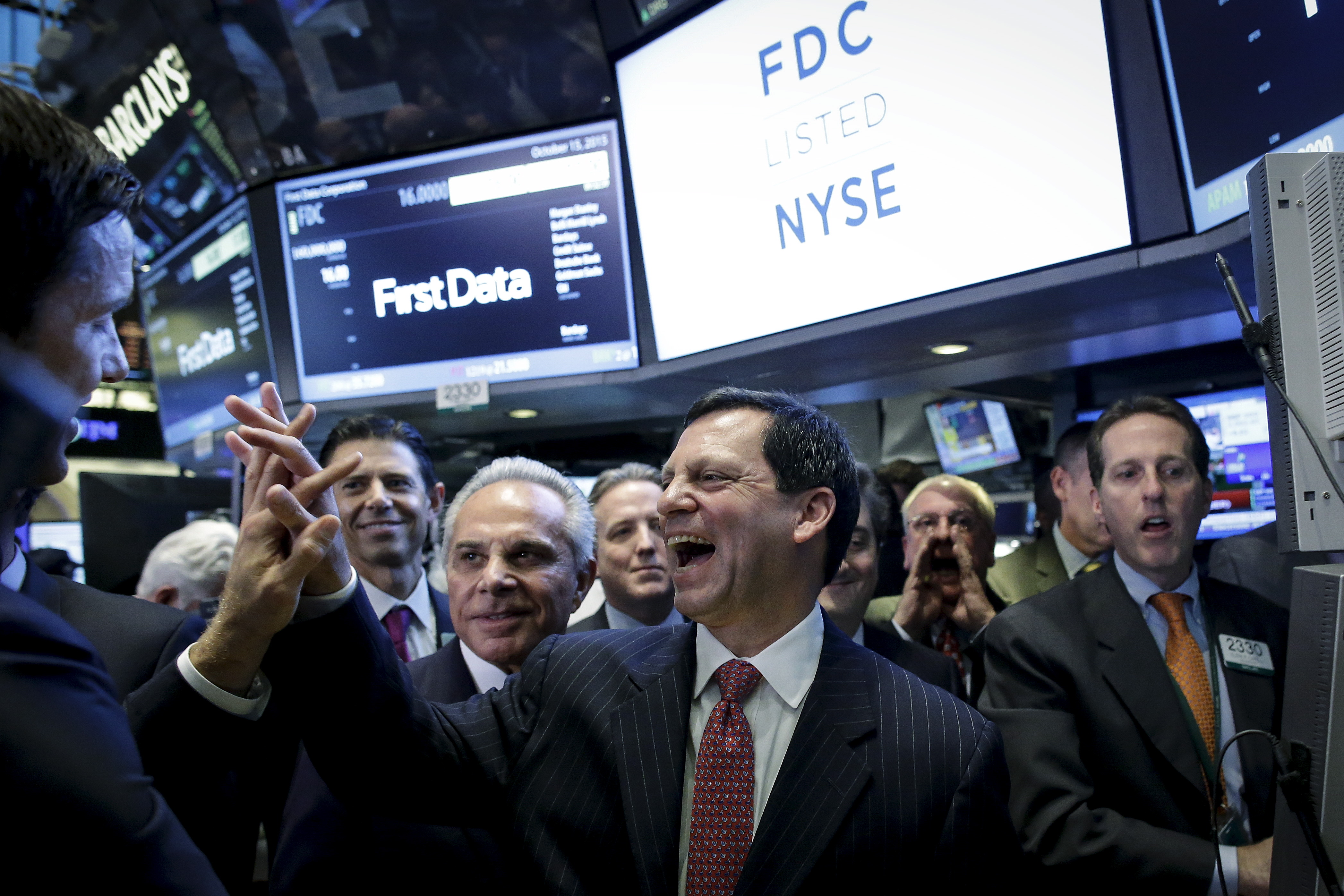 First Data Chairman and Chief Executive Frank Bisignano (C) celebrates during his company's initial public offering on the floor of the New York Stock Exchange
