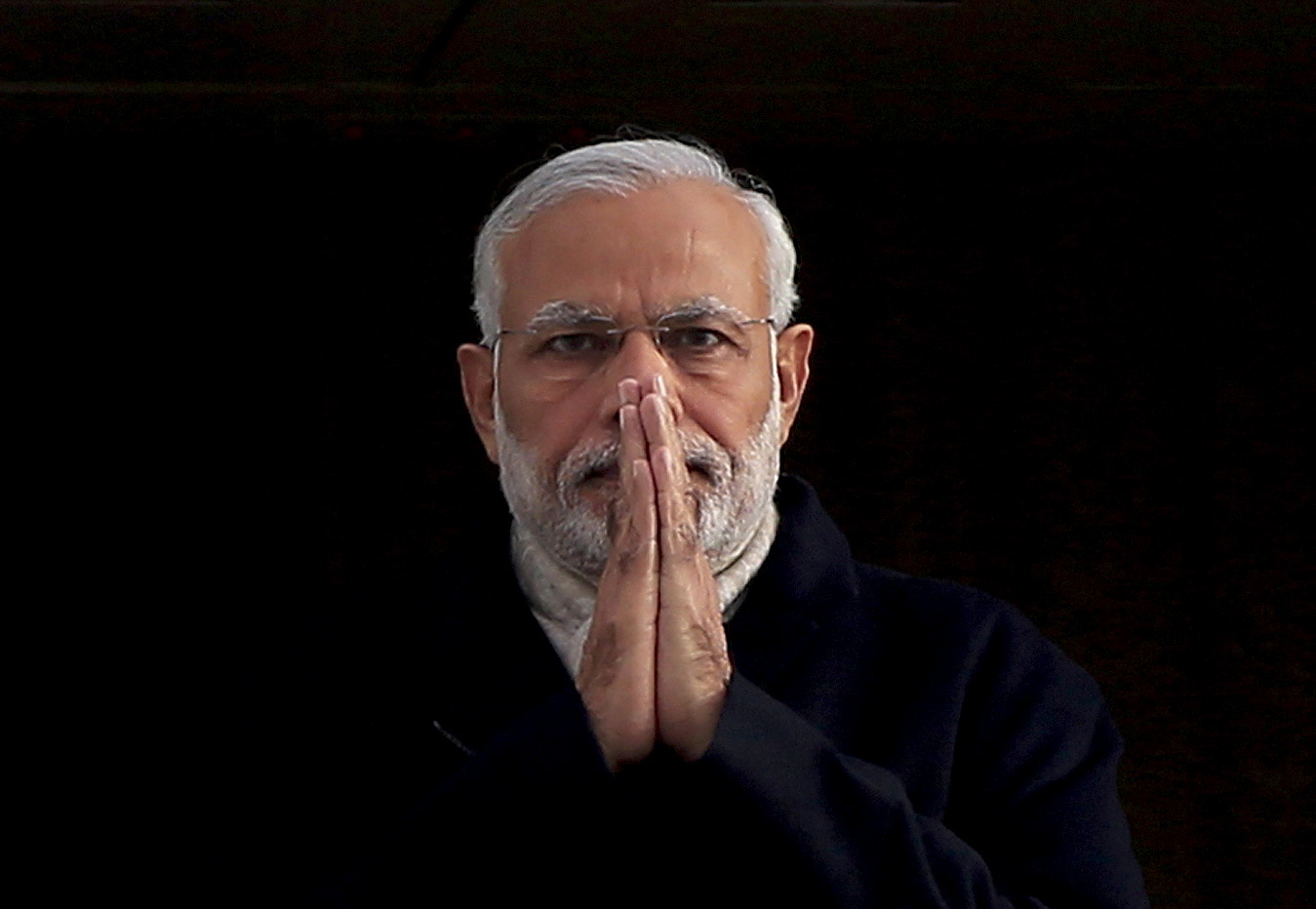 """India's Prime Minister Narendra Modi holds up his hands in a """"namaste"""", an Indian gesture of greeting, as he arrives at Heathrow Airport for a three-day official visit, in London"""
