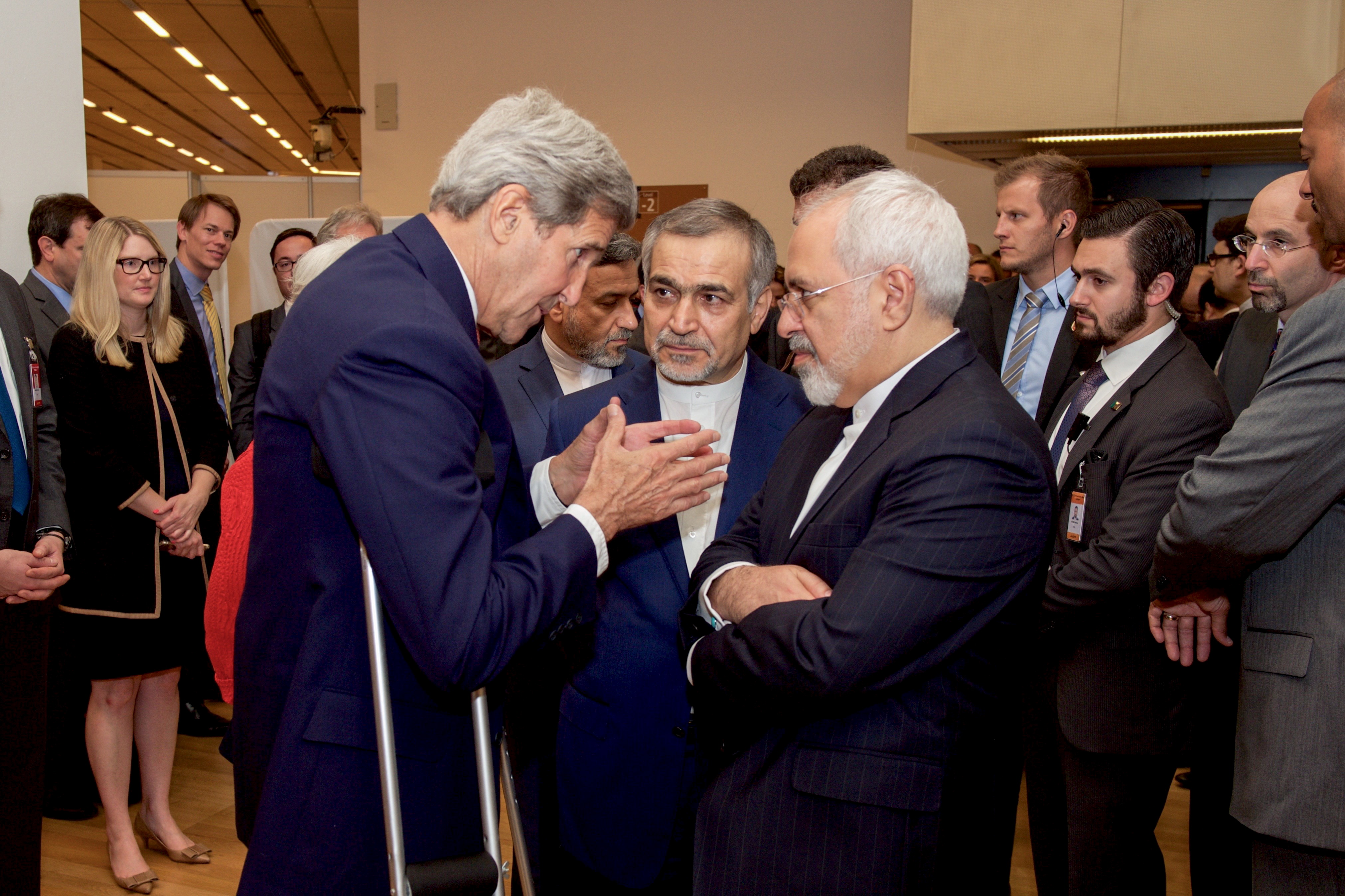 John Kerry speaks with Hossein Fereydoun and Iranian Foreign Minister Javad Zarif before the Secretary and Foreign Minister addressed an international press corps gathered at the Austria Center in Vienna
