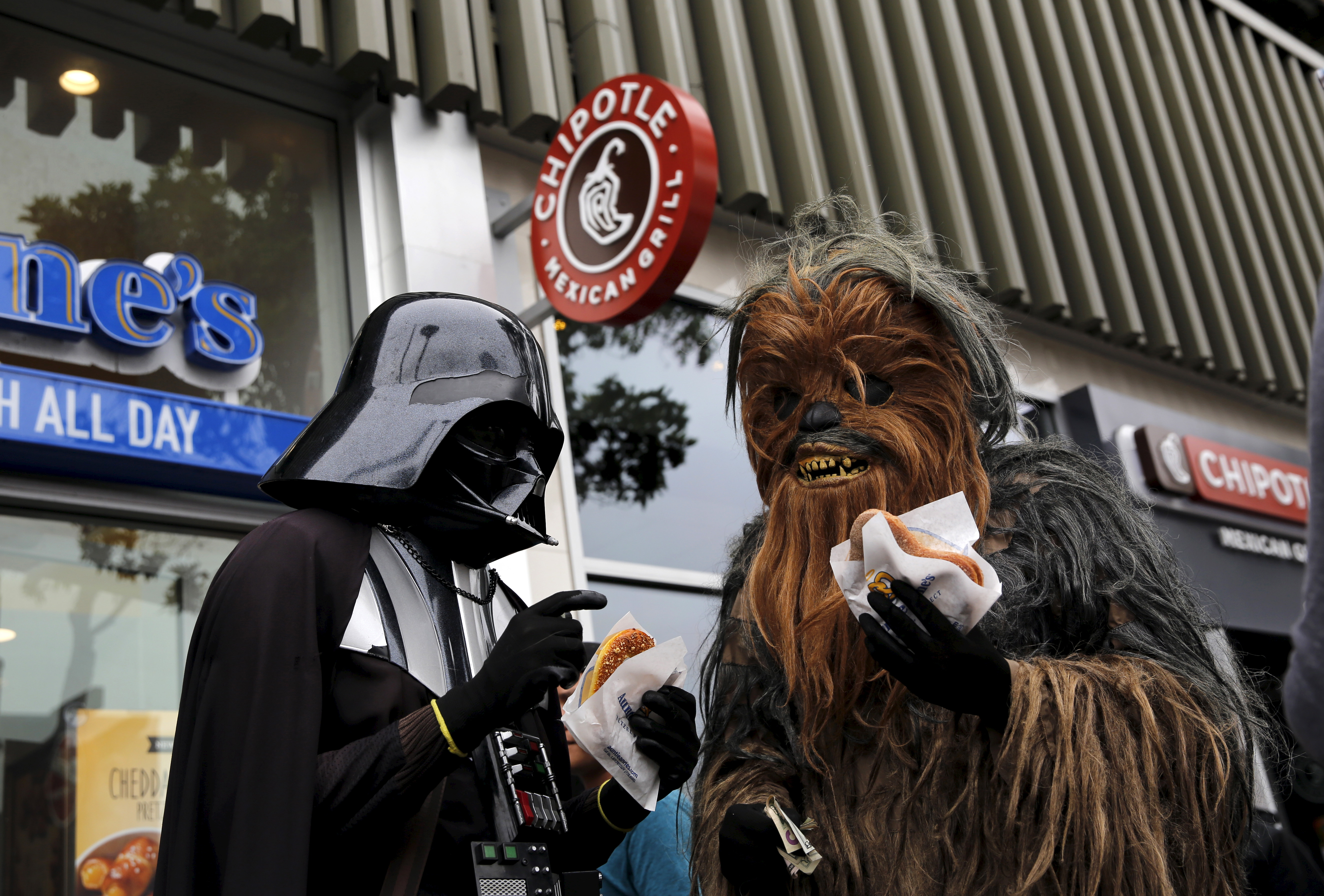 People wearing Star Wars-themed costumes eat pretzels in San Francisco, California