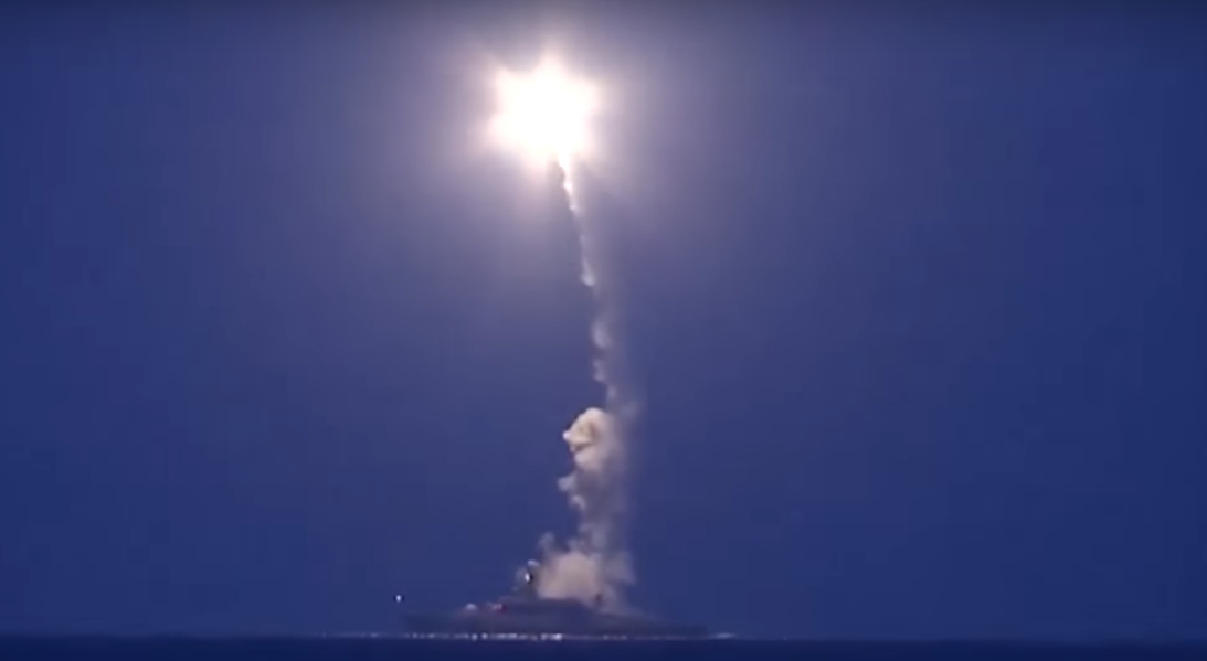 This screen capture of video shows Russian ships launching cruise missiles at targets in Syria.