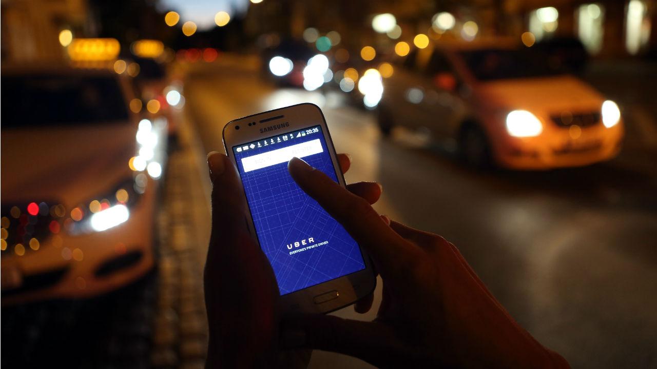A passenger using the Uber app.