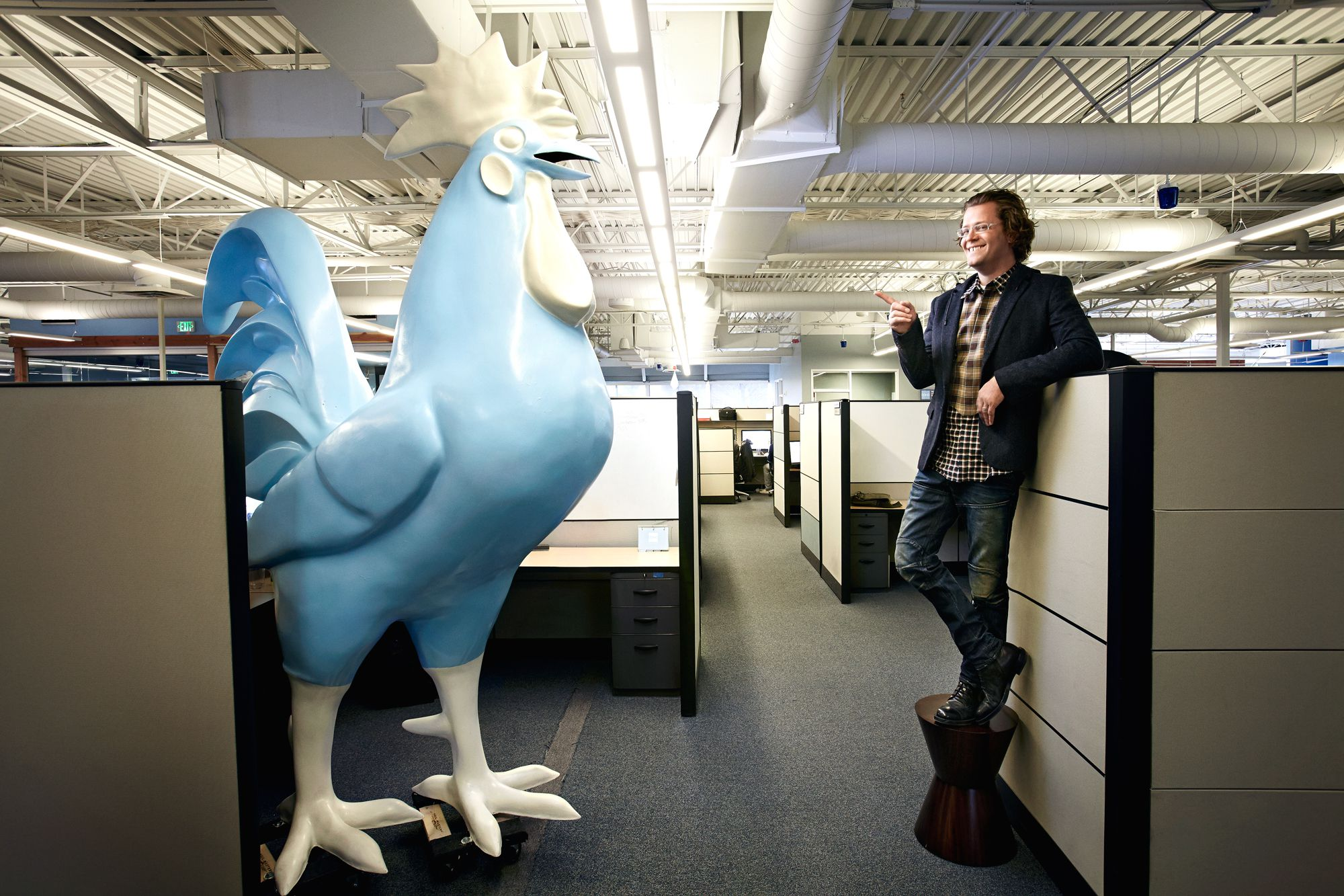 Don't fear the rooster: James with one of his motivational tools at Domo headquarters in American Fork, Utah.