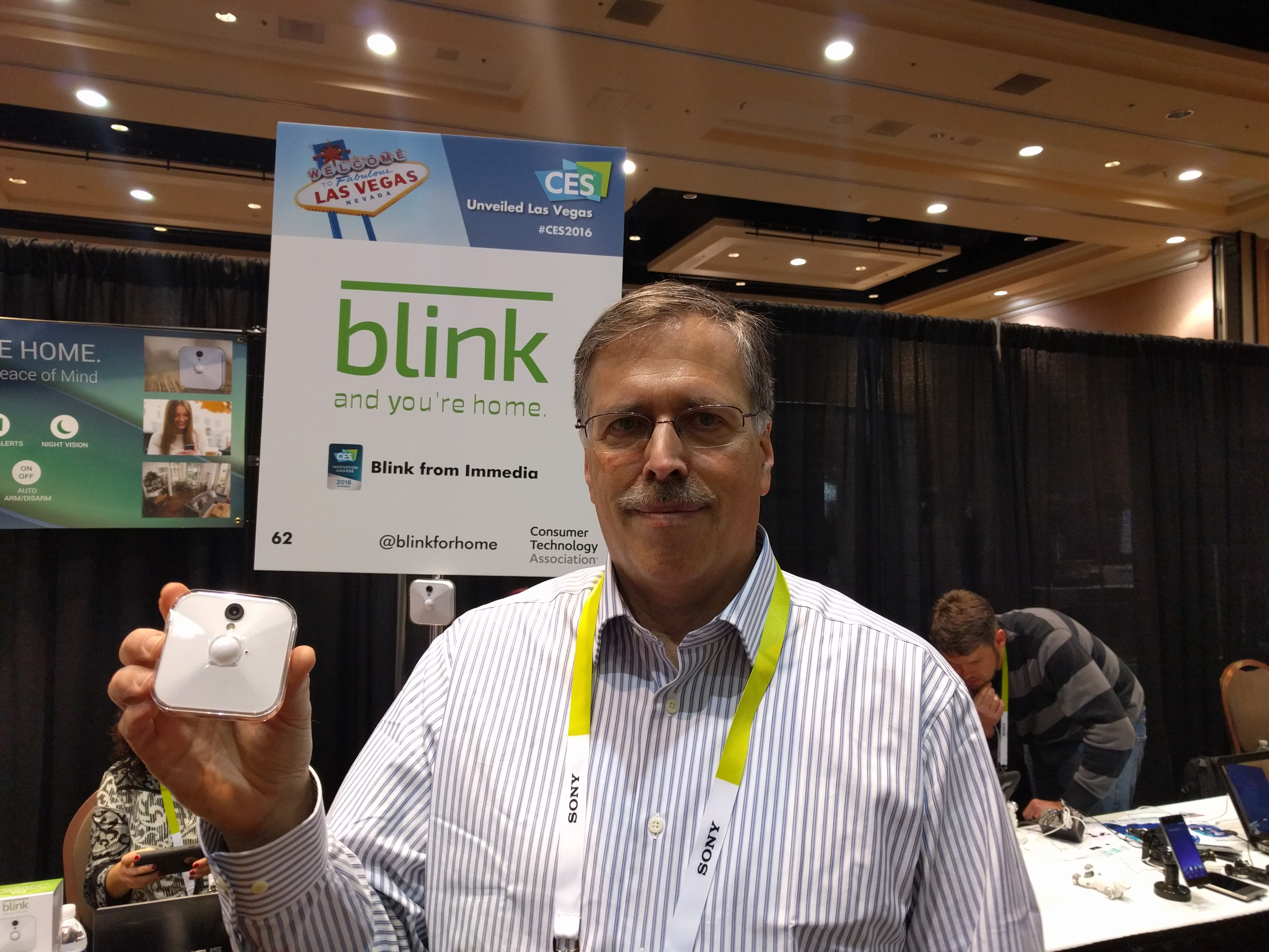 Peter Besen, CEO of Immedia, holding a Blink camera at CES 2016.