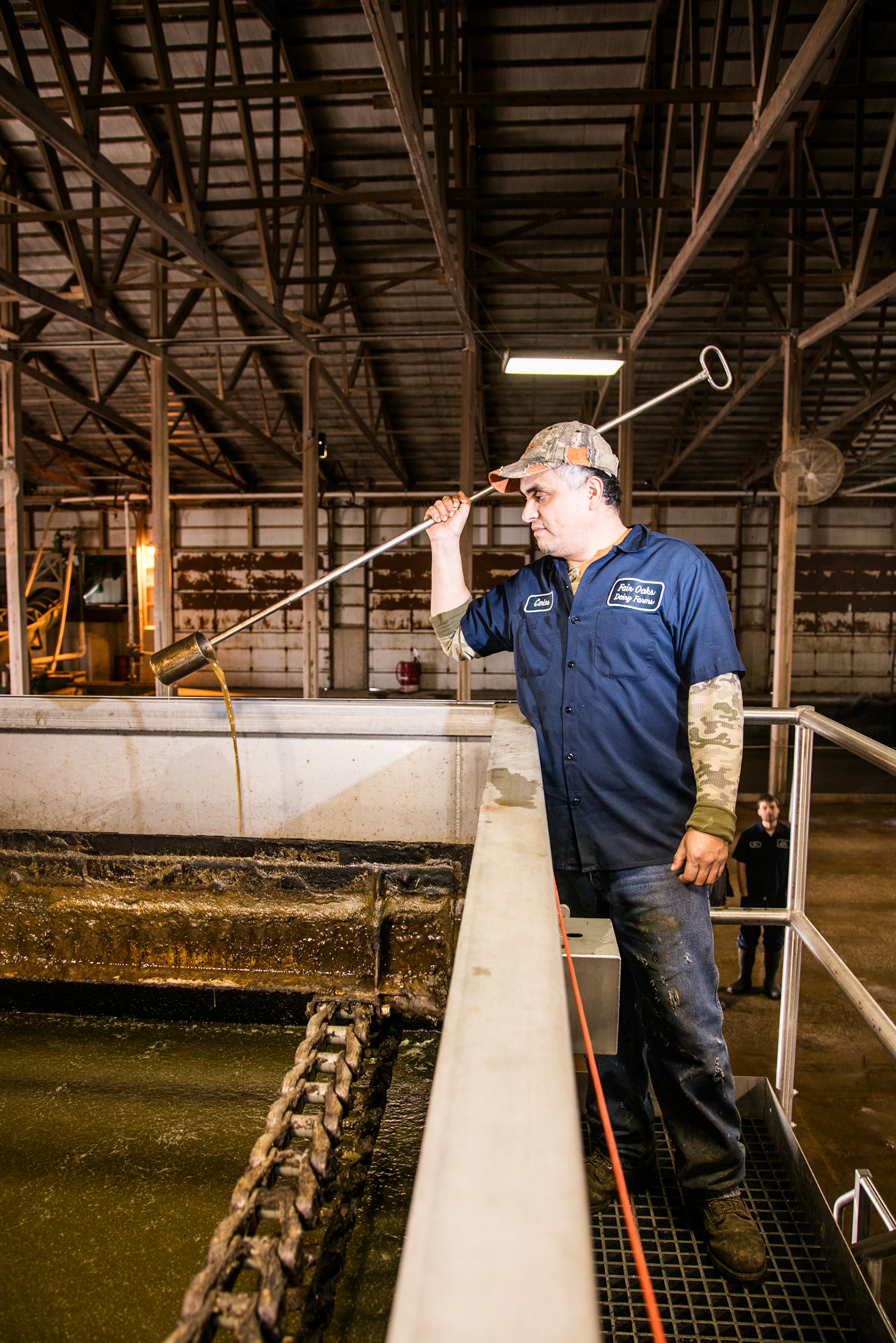 Carlos Hernandez, a plant operator, checks water clarity in a seperation tank at Fair Oaks Dairy in Fair Oaks, Ind., on January 7, 2016.
