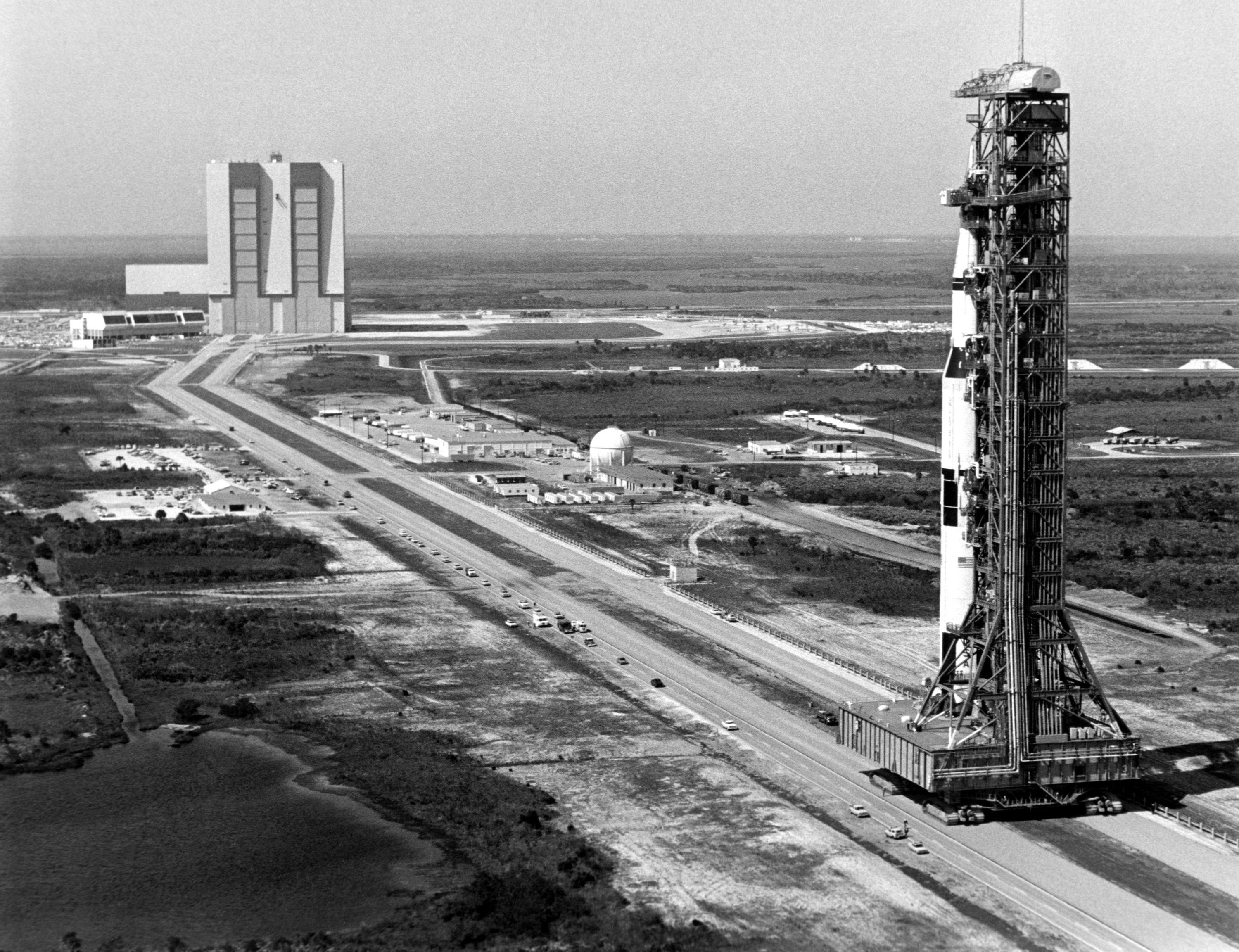 The 363-foot-high Saturn V rocket for the Apollo 10 mission towers over the crawlerway during its rollout from the Vehicle Assembly Building to Launch Pad 39B, four miles away. Apollo 10 marked the first use of Pad B. Astronauts Thomas P. Stafford and Eugene A. Cernan descended in a lunar module spacecraft to 50,000 feet above the moon's surface while John W. Young orbited above in the command module. Image credit: NASA March 11, 1969