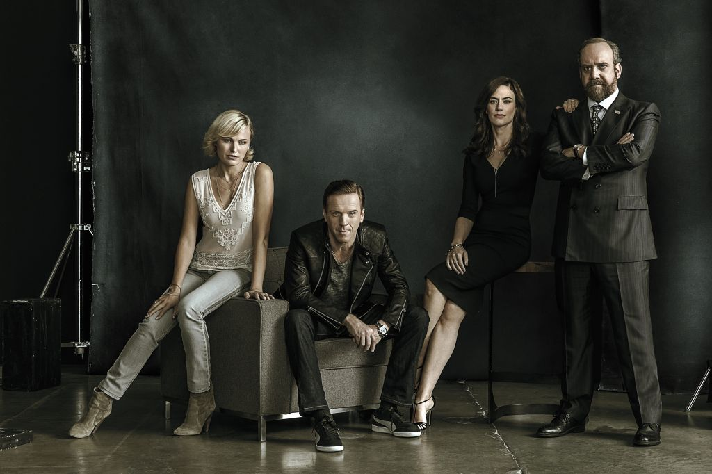 "Showtime original series Billions. - Photo: James Minchin/SHOWTIME - Photo ID: BILLIONS_PRArt_02.R Pictured: Malin Akerman as Lara Axelrod, Damian Lewis as Bobby ""Axe"" Axelrod, Maggie Siff as Wendy Rhoades and Paul Giamatti as Chuck Rhoades"