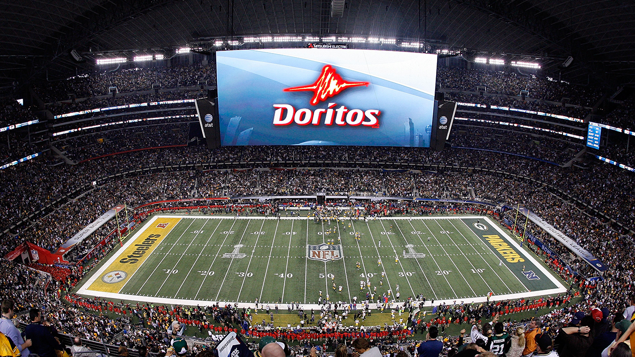 A Doritos ad is displayed on the screen during Super Bowl XLV at Cowboys Stadium on February 6, 2011 in Arlington, Texas.
