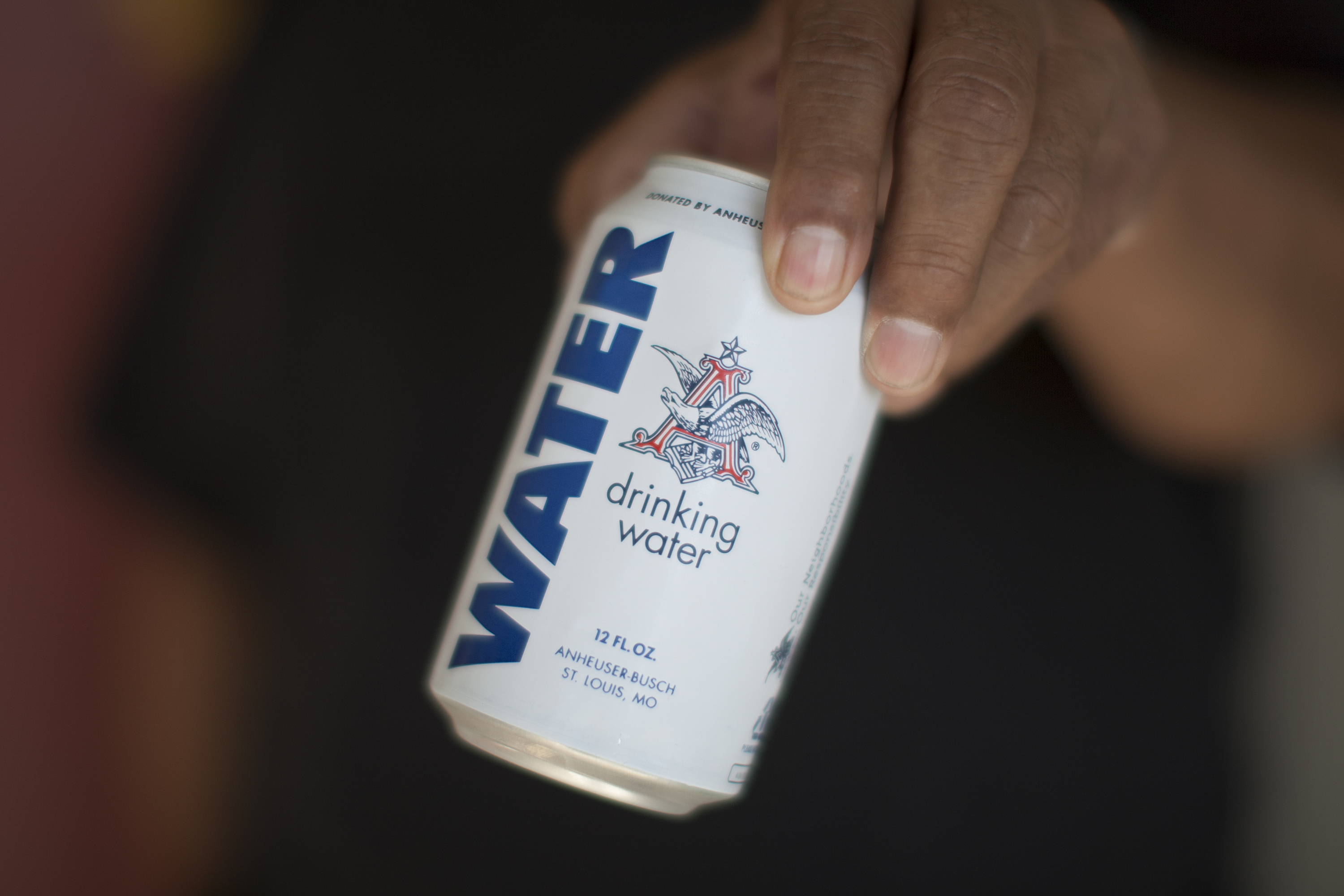 A can of Anheuser-Busch drinking water.