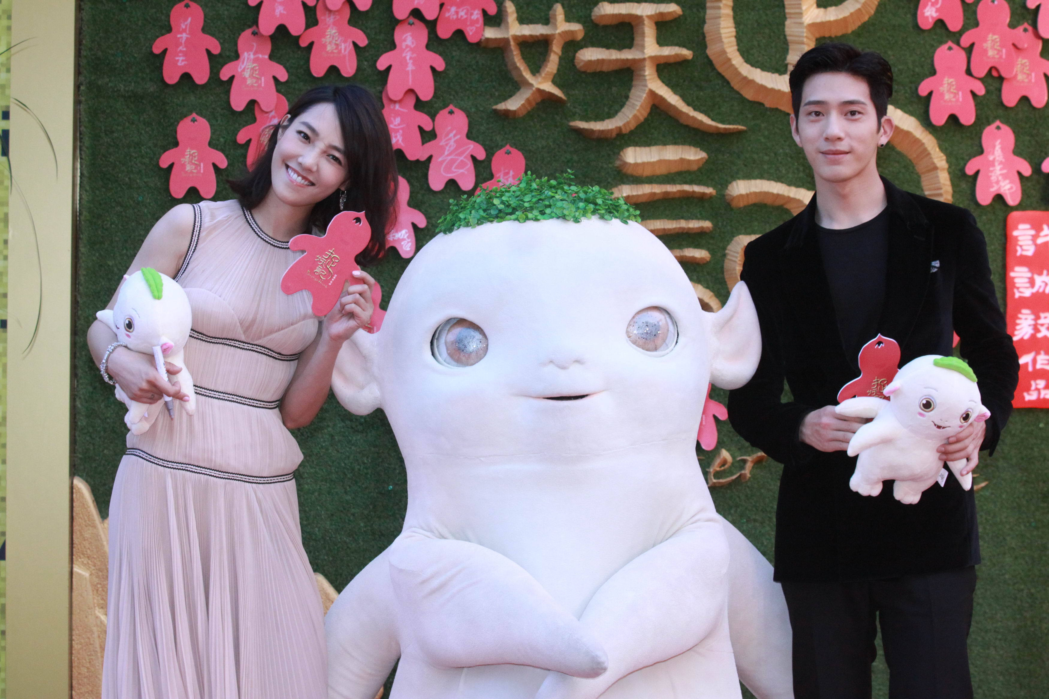 """BEIJING, CHINA - JULY 5: (CHINA OUT) Actress Bai Baihe and actor Jing Boran arrive at the red carpet for the premiere of new film """"Monster Hunt"""" directed by Xu Chengyi on July 5, 2015 in Beijing, China. (Photo by ChinaFotoPress)***_***"""