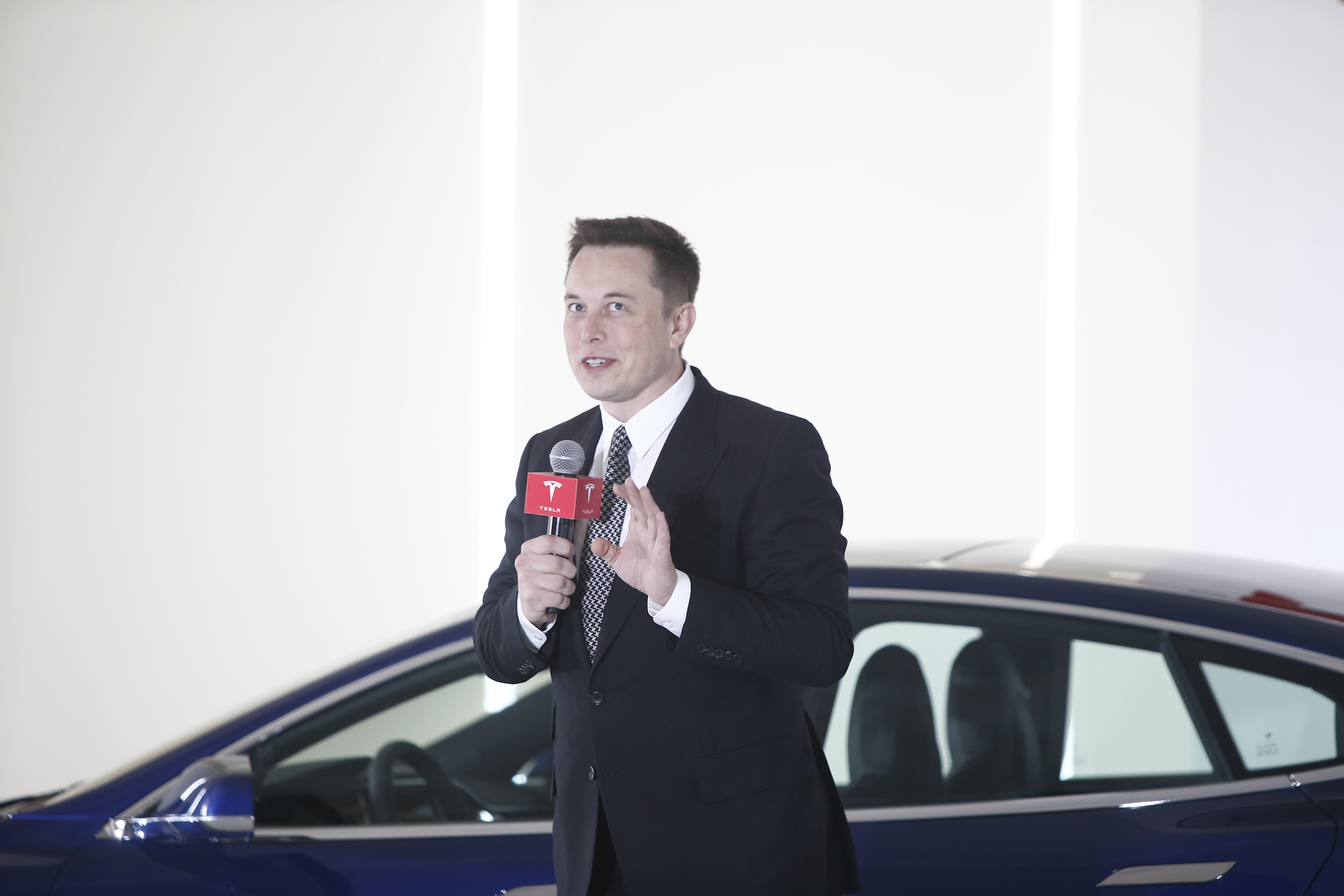 Tesla Ceo Elon Musk Says Apple Making Electric Car Is Open