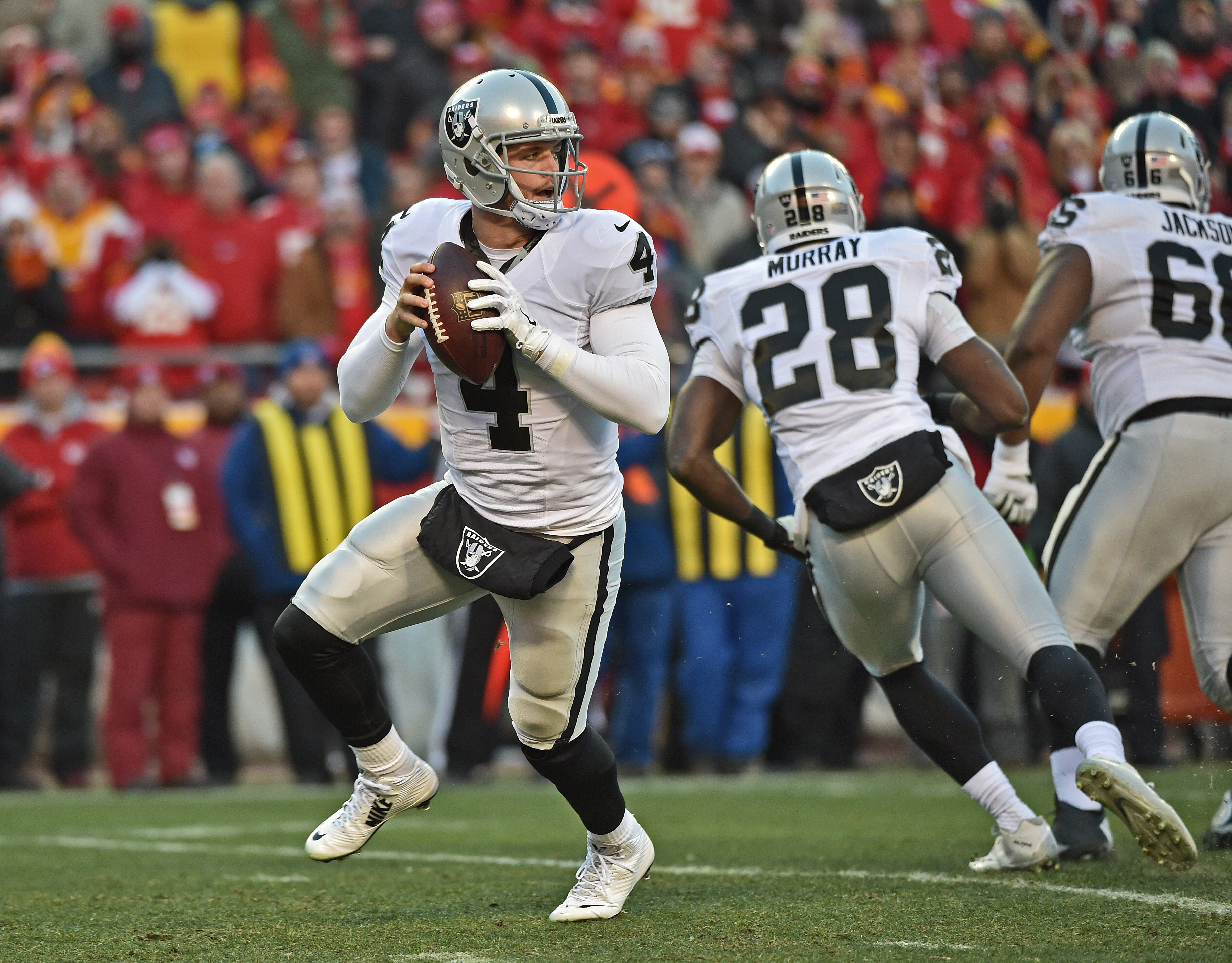 Quarterback Derek Carr #4 of the Oakland Raiders drops back to pass against the Kansas City Chiefs during the first half on January 3, 2016 at Arrowhead Stadium in Kansas City, Missouri