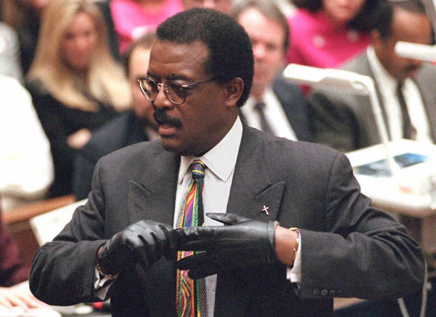 Defense lawyer Johnnie Cochran Jr. puts on a glove