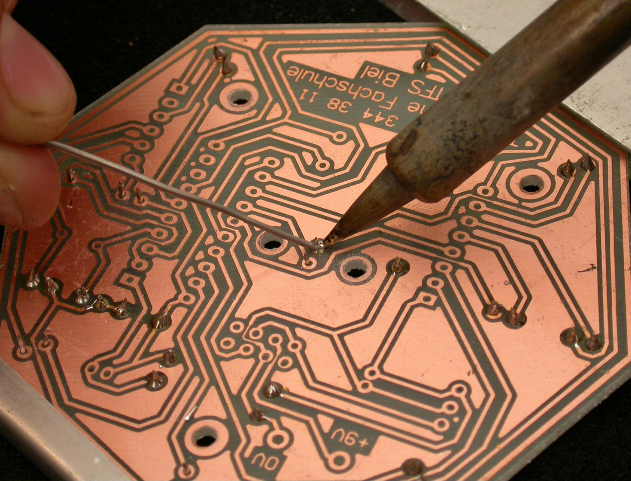 Soldering a connection on a PCB 2005