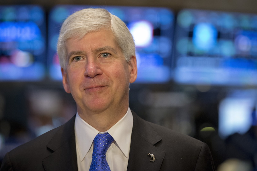 Michigan Governor Rick Snyder gives an interview on the floor of the New York Stock Exchange
