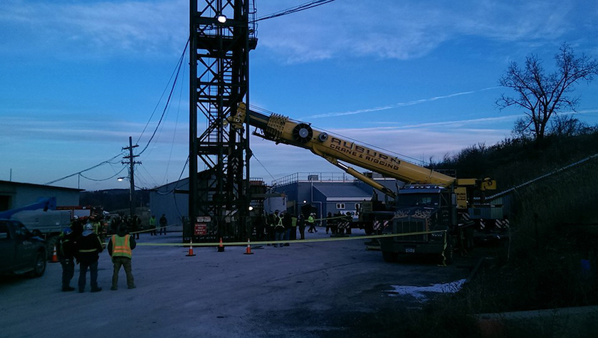 The Ithaca Fire Department uses a crane to lift miners from the Cargill salt mine in Lansing