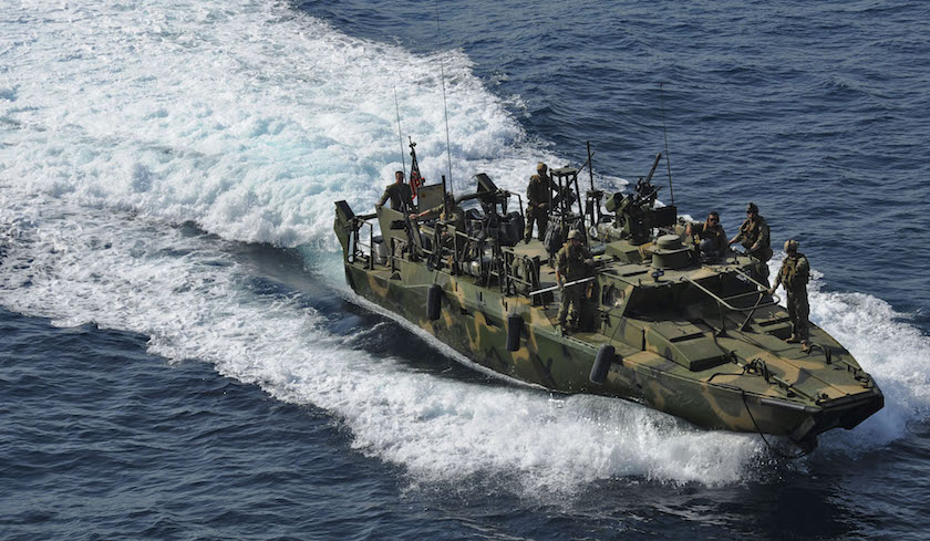U.S. Navy handout photo of a riverine command boat from Riverine Detachment 23 operates during a maritime air support operations center exercise in the Arabia Gulf