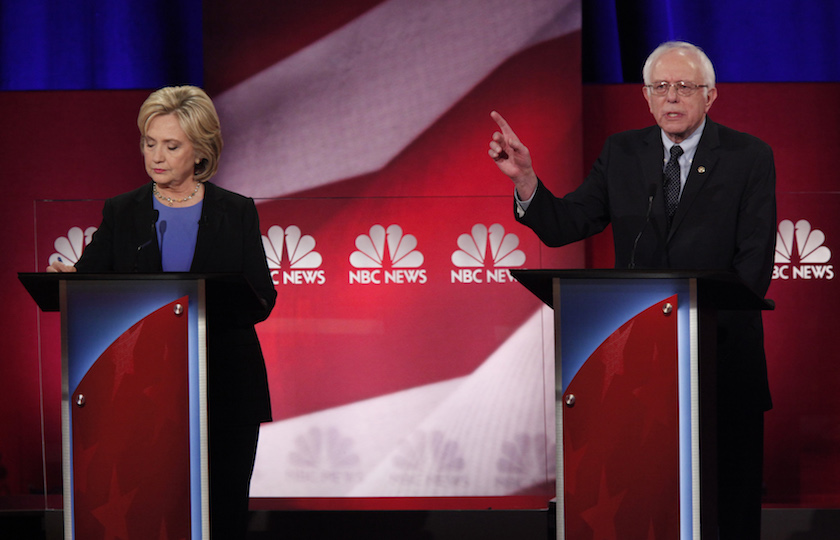 Democratic U.S. presidential candidate and former Secretary of State Hillary Clinton takes notes as she listens to rival candidate U.S. Senator Bernie Sanders speak at the NBC News - YouTube Democratic presidential candidates debate in Charleston