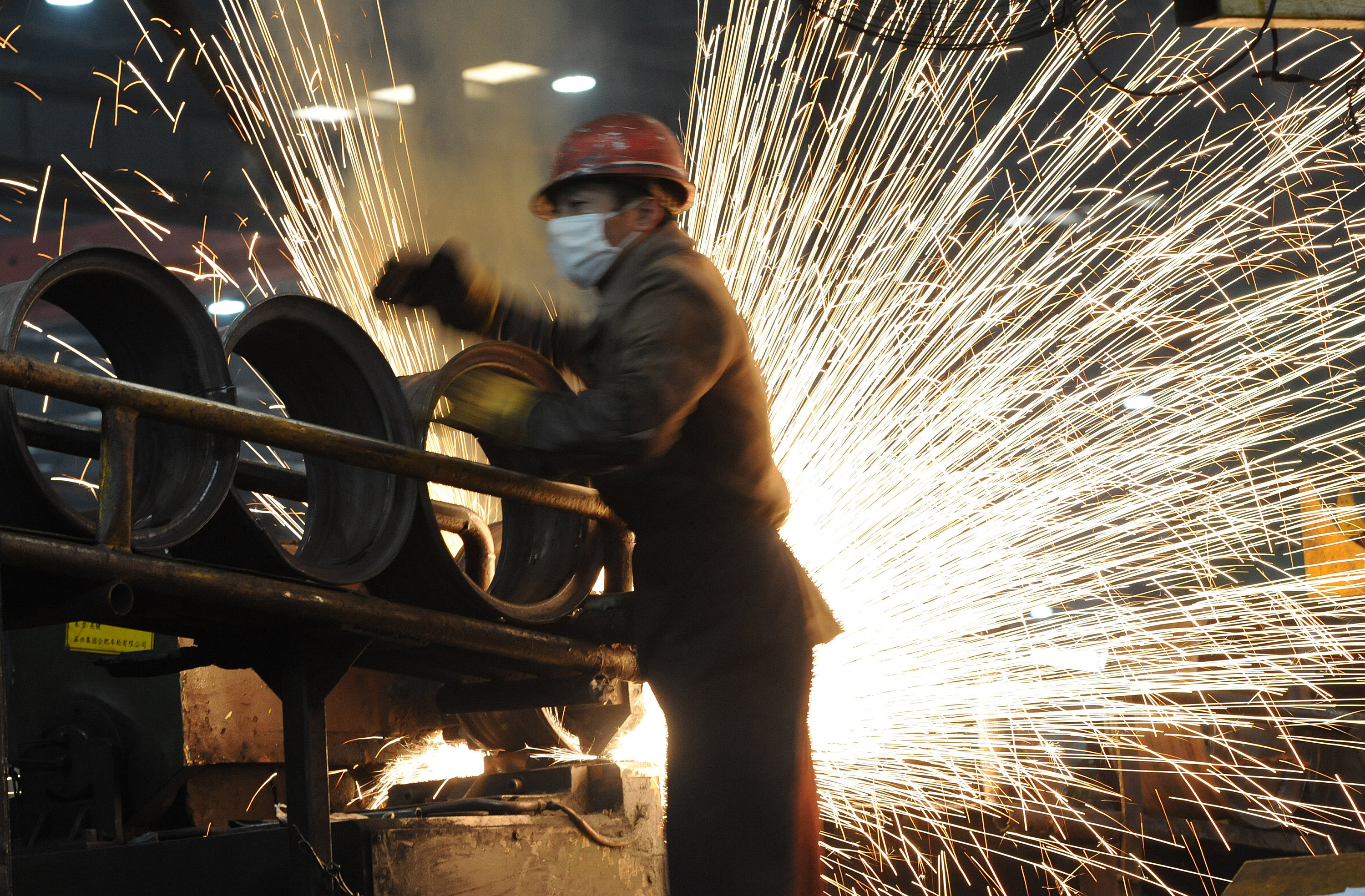 A Chinese worker goes about his chores at a steel mill in Hefei, in eastern China's Anhui province.