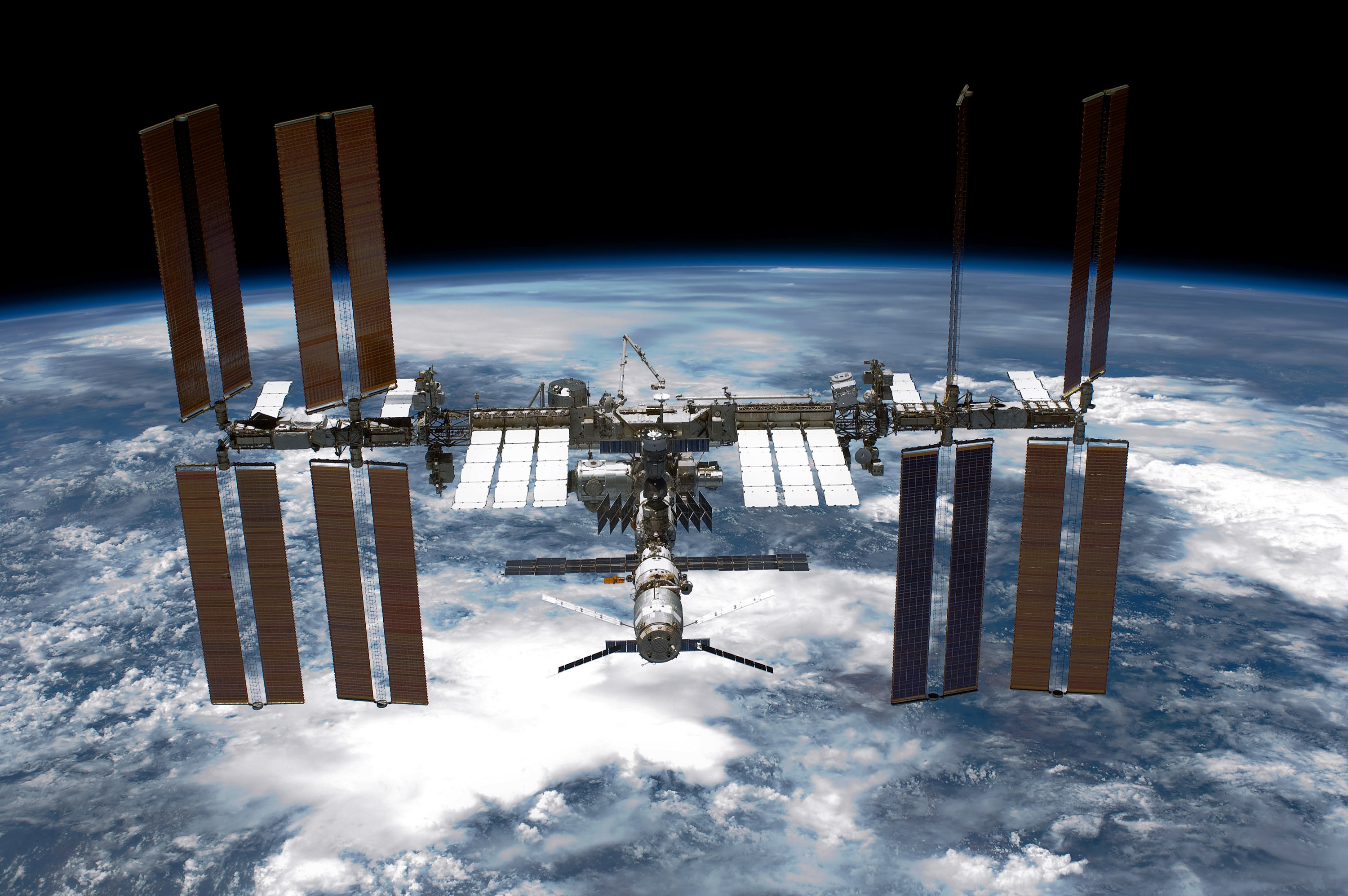 IN SPACE - MAY 29:  In this handout provided by National Aeronautics and Space Administration (NASA), back dropped by planet Earth the International Space Station (ISS) is seen from NASA space shuttle Endeavour after the station and shuttle began their post-undocking relative separation May 29, 2011 in space. After 20 years, 25 missions and more than 115 million miles in space, NASA space shuttle Endeavour is on the last leg of its final flight to the International Space Station before being retired and donated to the California Science Center in Los Angeles. Capt. Mark E. Kelly, U.S. Rep. Gabrielle Giffords' (D-AZ) husband, has lead mission STS-134 as it delivered the Express Logistics Carrier-3 (ELC-3) and the Alpha Magnetic Spectrometer (AMS-2) to the International Space Station. (Photo by NASA via Getty Images)
