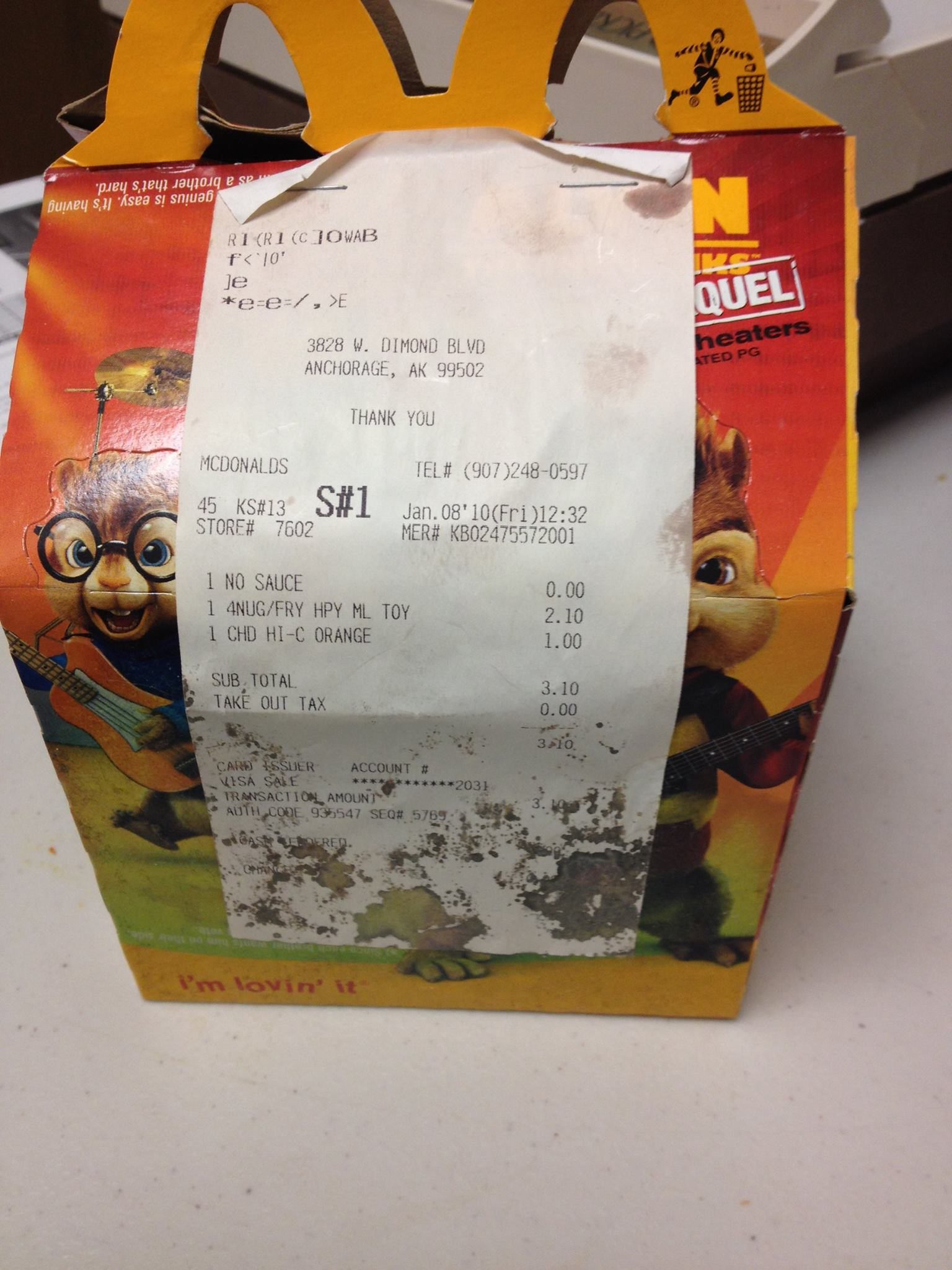 McDonald's Happy Meal with receipt showing purchase date of Jan. 8, 2010.