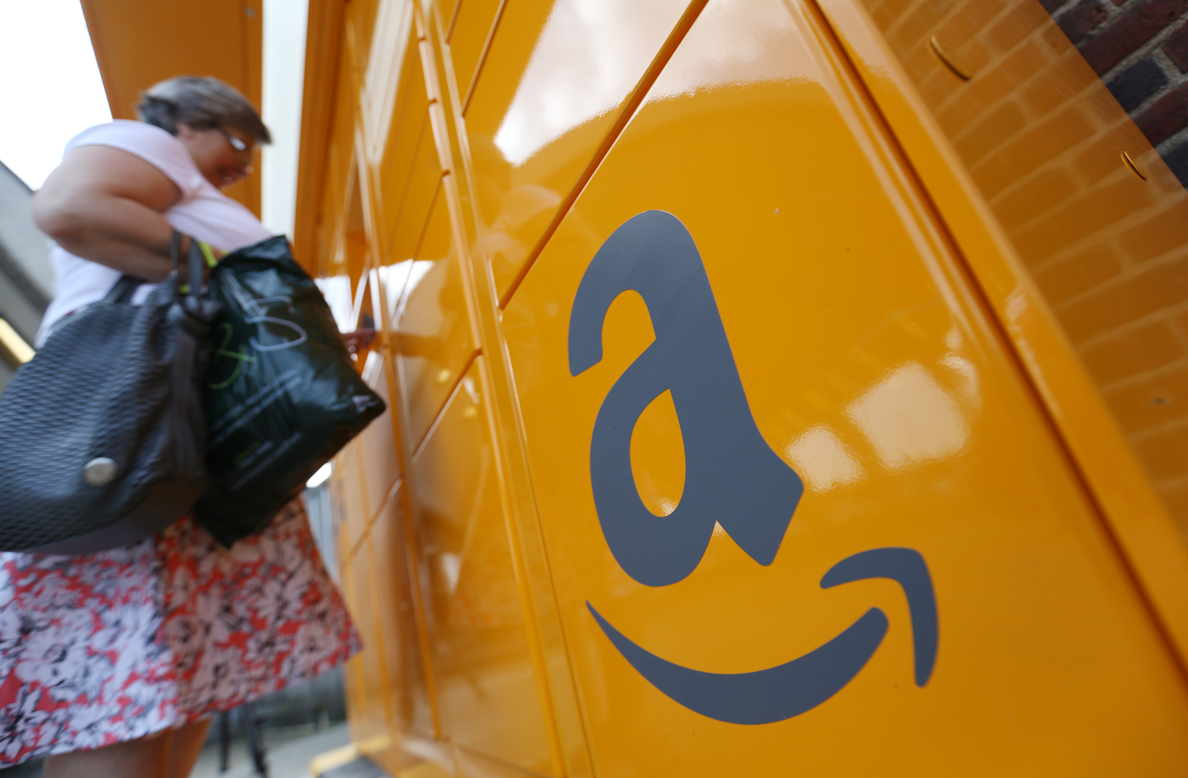 Customers Collect Online Orders From An Amazon.com Inc. Locker