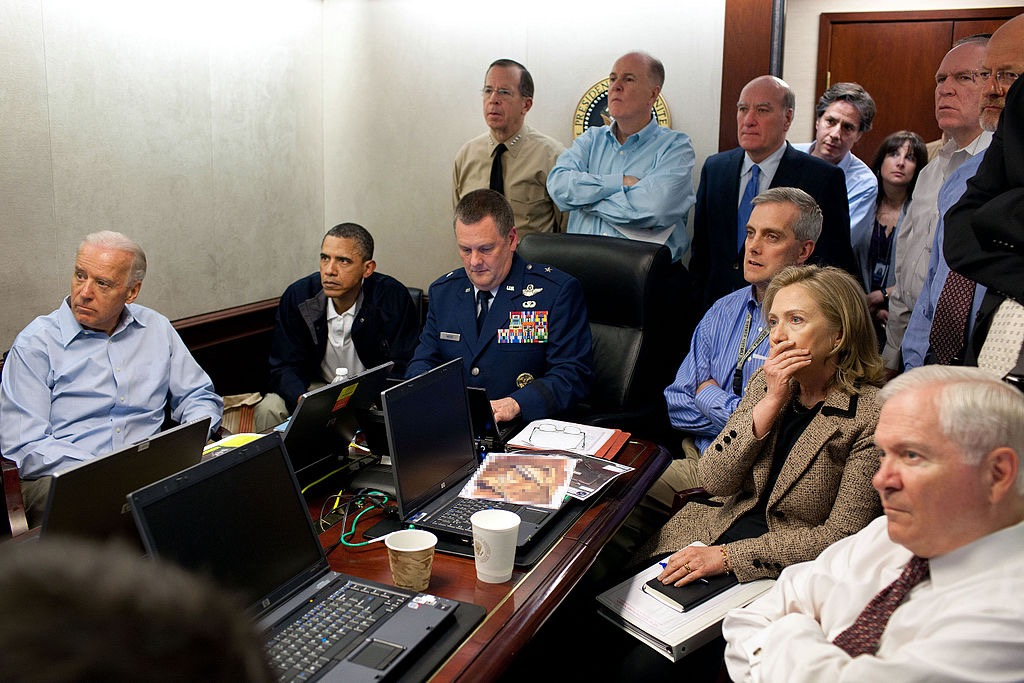 That's McDonough in the blue shirt, arms folded, seated third from right, in the Situation Room during the raid that killed Bin Laden.