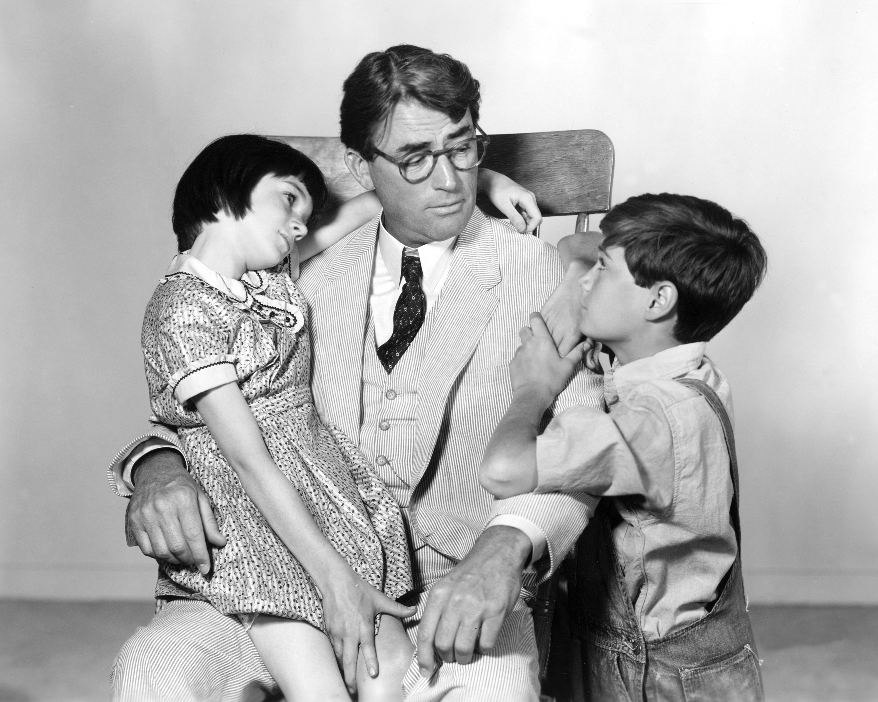 Gregory Peck as Atticus Finch, Mary Badham as Jean Louise 'Scout' Finch and Phillip Alford as Jeremy 'Jem' Finch in To Kill a Mockingbird