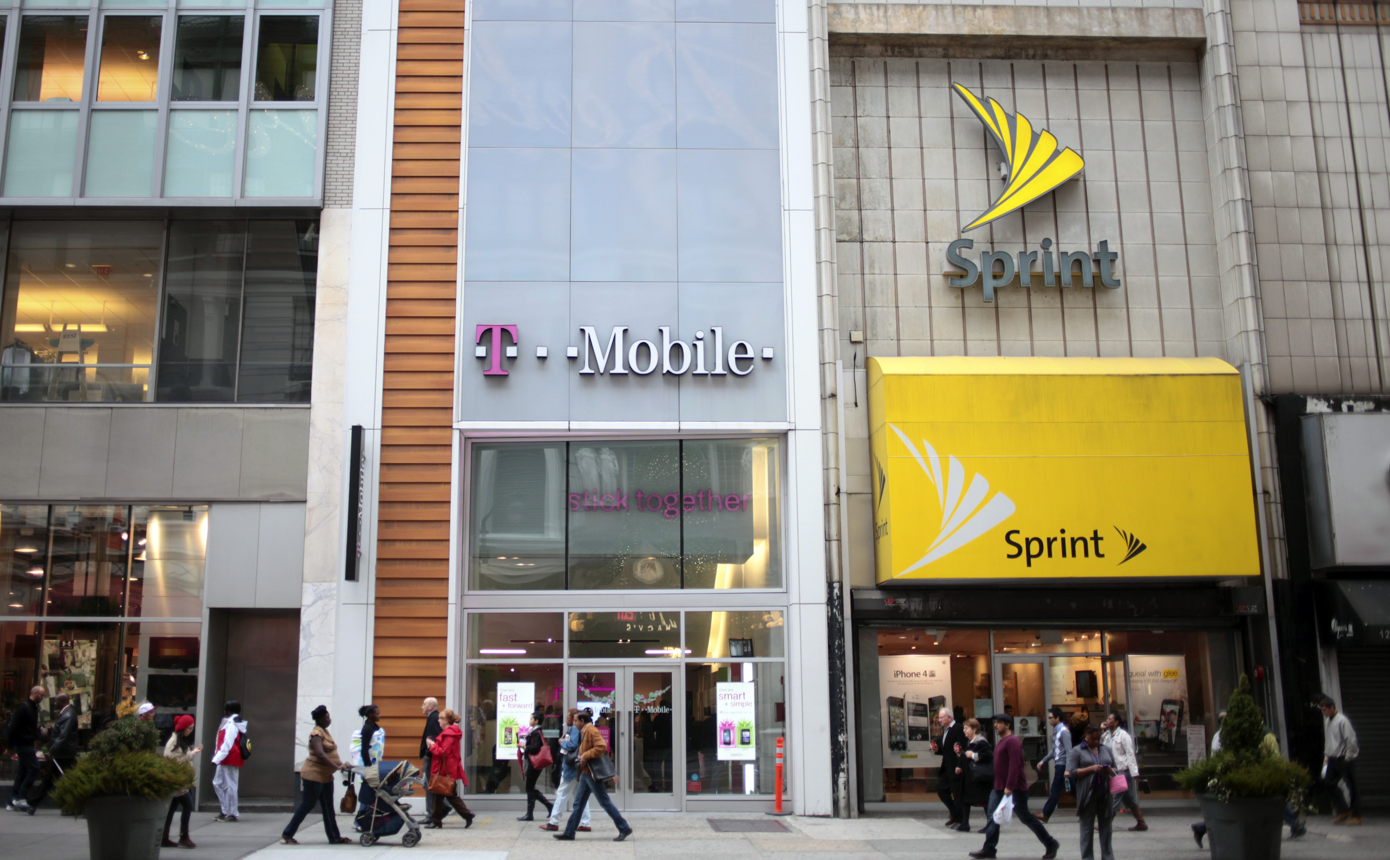 T-Mobile USA Boosts Customers as Takeover by AT&T Drags On