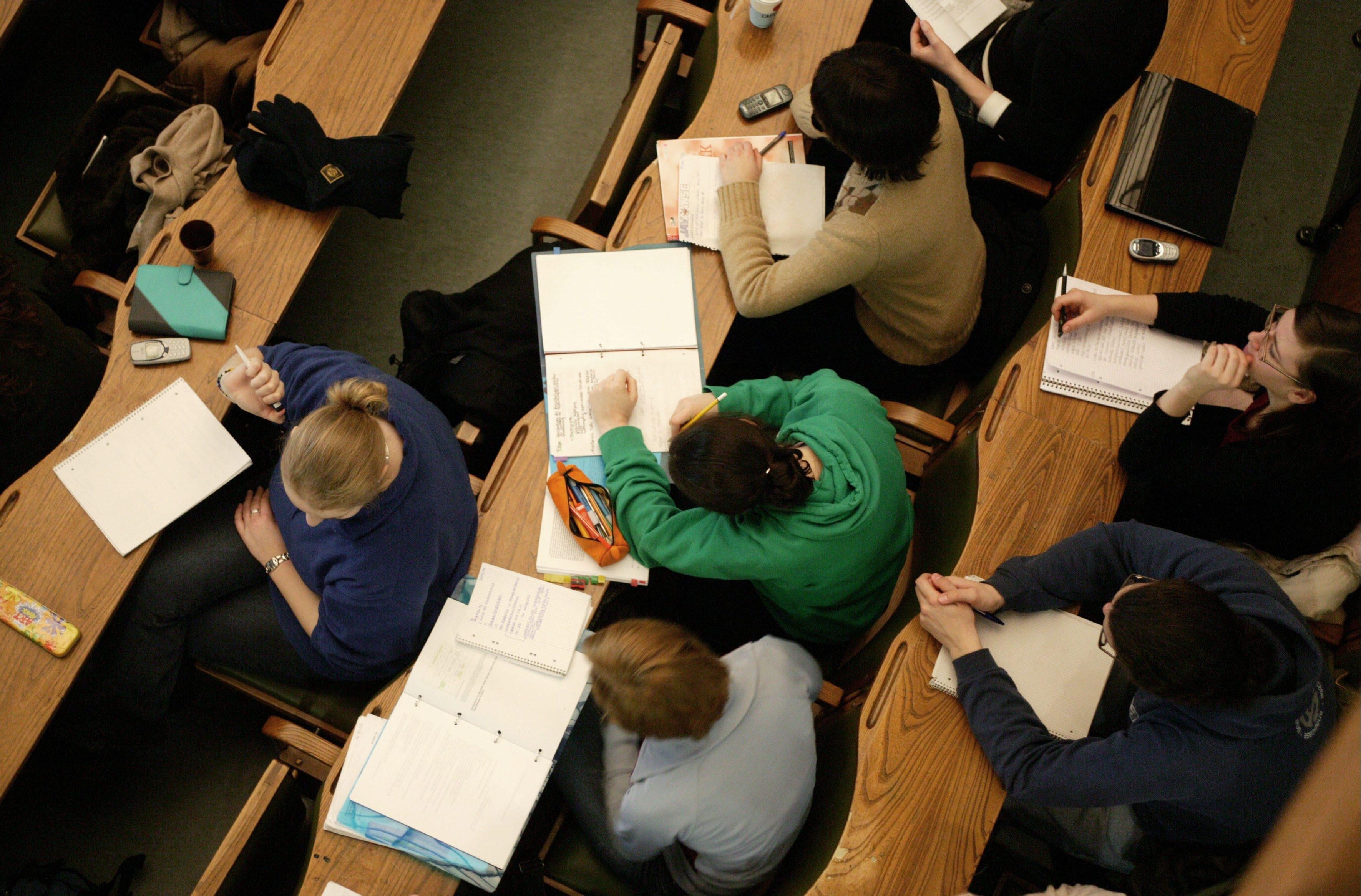 Students inside lecture hall of the Rheinische Friedrich Wilhelms University of Bonn.