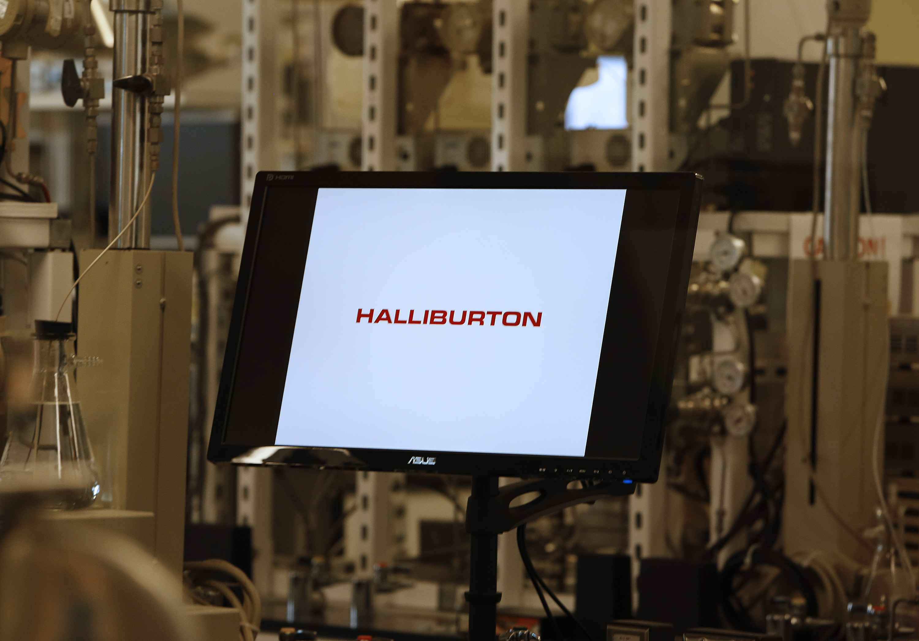 The Halliburton Co. logo is seen on a computer monitor at the company's facility in Houston, Texas, U.S., on Thursday, May 9, 2013. Halliburton Co., the world?s largest provider of hydraulic-fracturing services, reported last month that first-quarter results beat analysts? estimates as the company reduced costs in North America. Photographer: Aaron M. Sprecher/Bloomberg via Getty Images